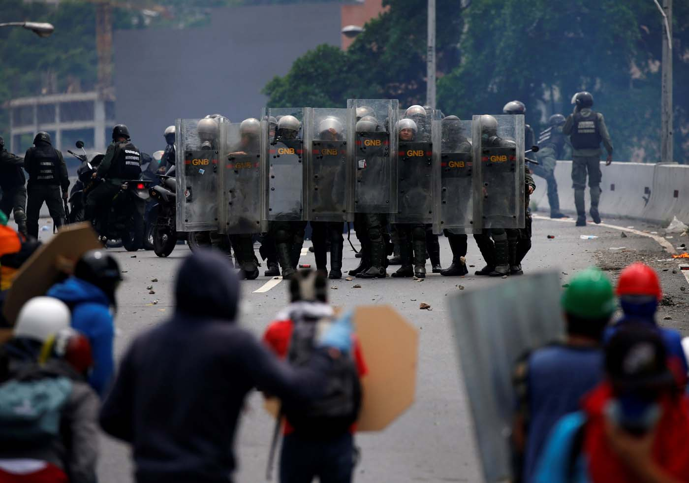 Riot police take position while clashing with opposition supporters rallying against President Nicolas Maduro in Caracas, Venezuela, May 3, 2017. REUTERS/Carlos Garcia Rawlins