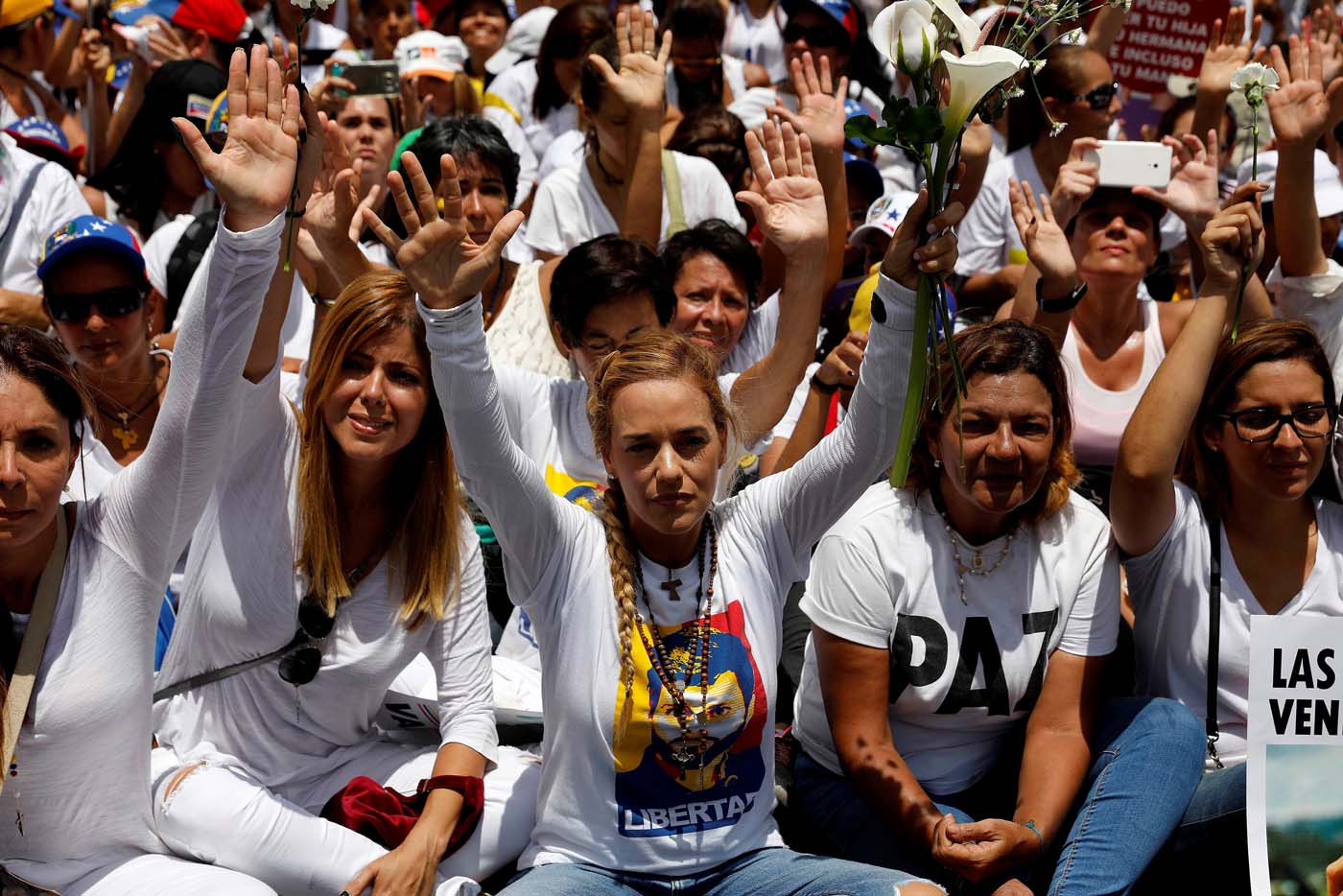 Lilian Tintori (C), wife of jailed Venezuelan opposition leader Leopoldo Lopez, lifts her hands during a women's march to protest against President Nicolas Maduro's government in Caracas, Venezuela May 6, 2017. REUTERS/Carlos Garcia Rawlins