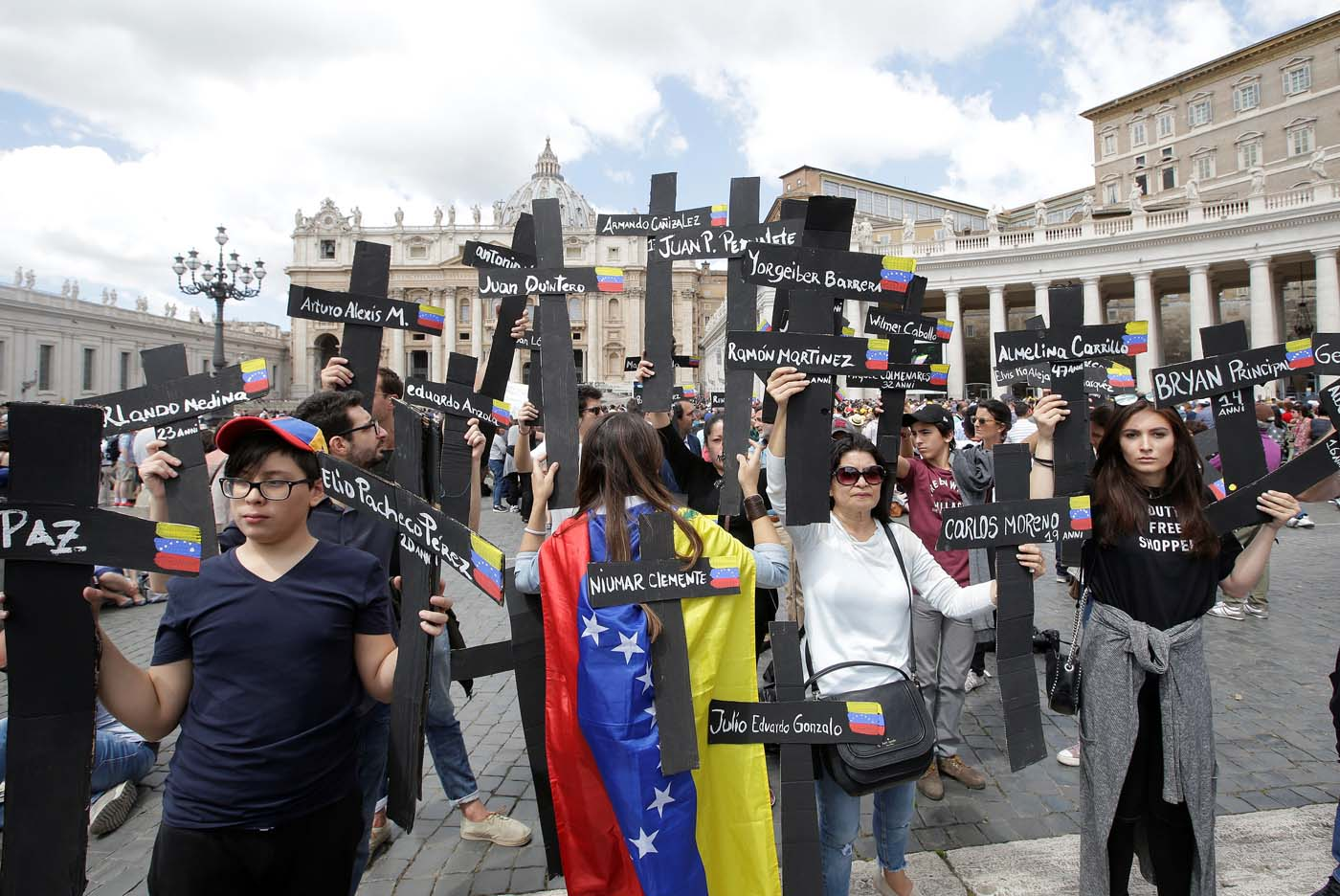 The faithful from Venezuela hold crosses with names of people who died during protests in Venezuela, before the Regina Coeli prayer led by Pope Francis in Saint Peter's Square at the Vatican May 7, 2017. REUTERSMax Rossi