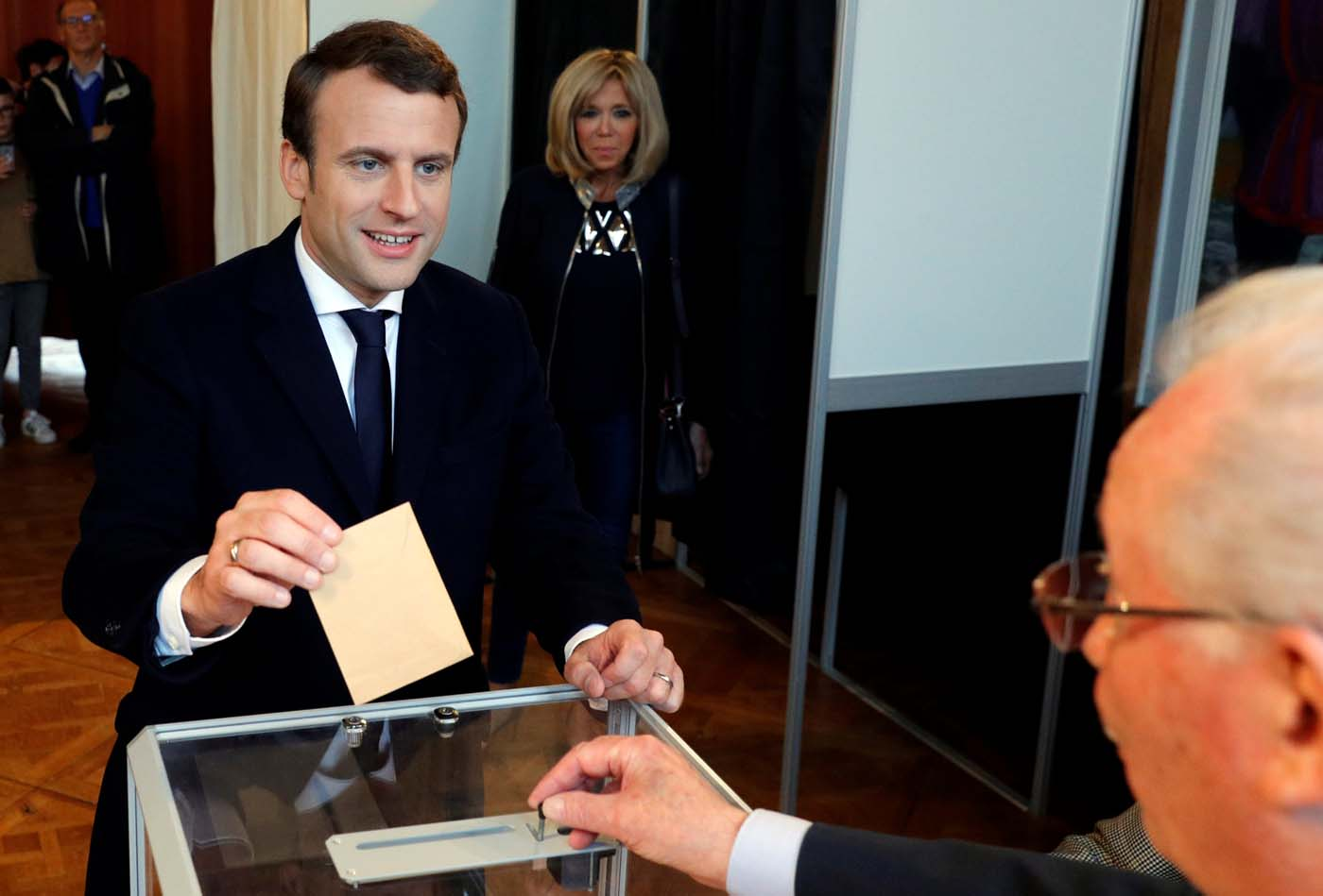 French presidential election candidate Emmanuel Macron, head of the political movement En Marche !, or Onwards ! casts his ballot at a polling station during the the second round of 2017 French presidential election, in Le Touquet, France, May 7, 2017. REUTERS/Philippe Wojazer