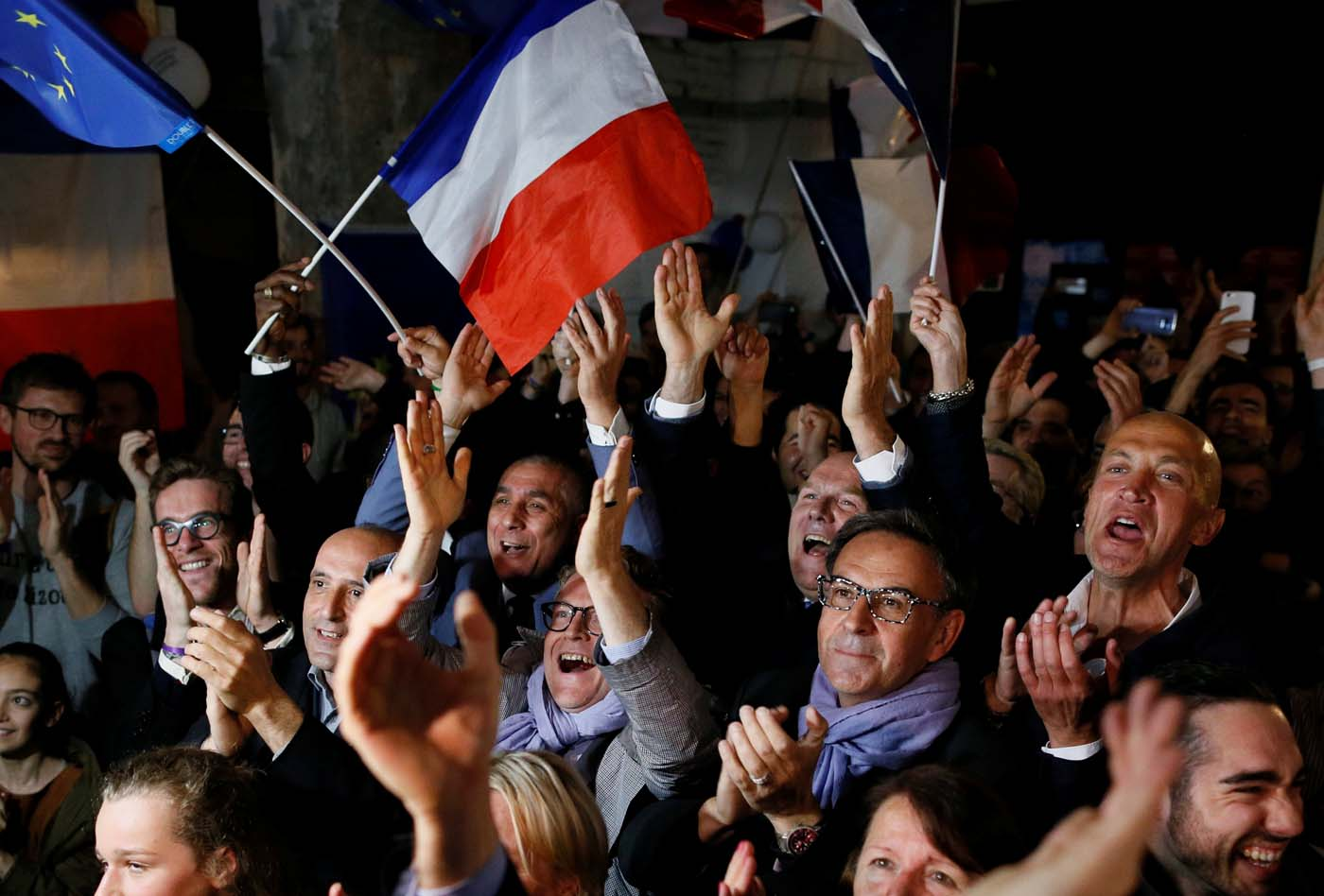 Supporters of Emmanuel Macron celebrate after the second round of 2017 French presidential election, in Lyon, France, May 7, 2017. REUTERS/Robert Pratta