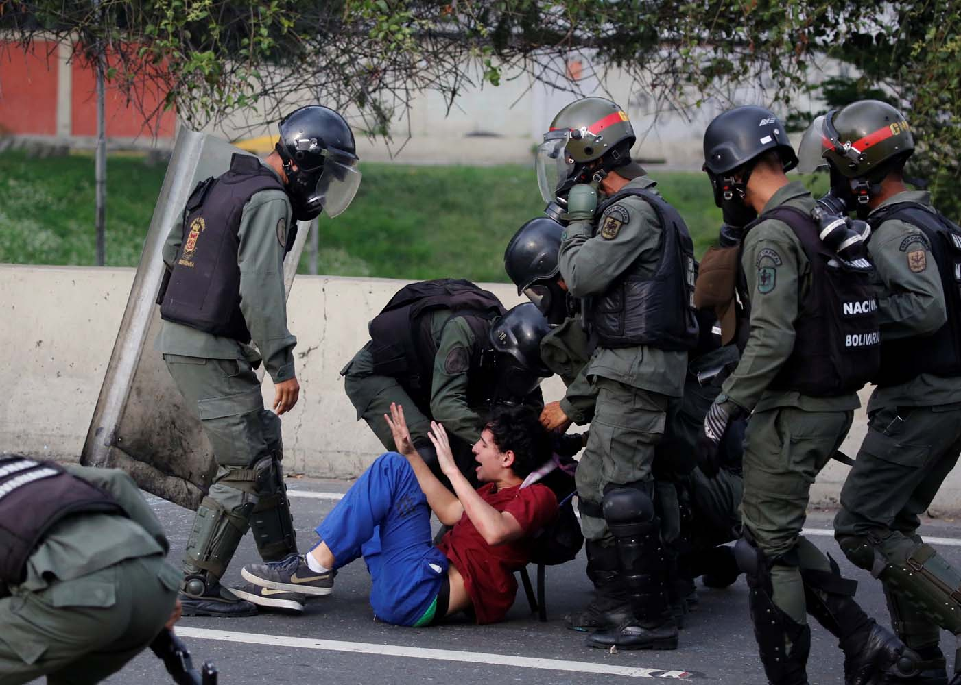 An opposition supporter is detained by riot police during a rally against President Nicolas Maduro in Caracas, Venezuela, May 8, 2017. REUTERS/Carlos Garcia Rawlins