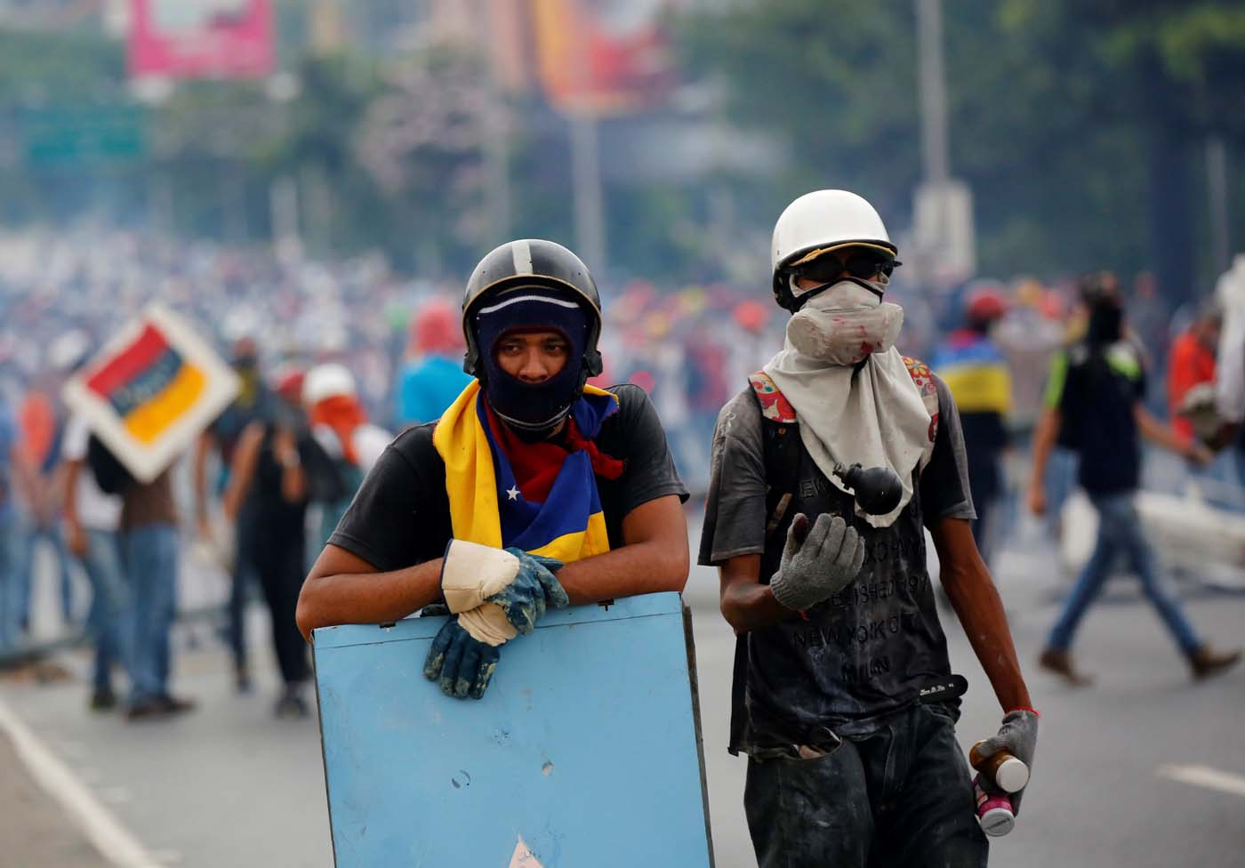 Opposition supporters look on while rallying against Venezuelan President Nicolas Maduro in Caracas, Venezuela, May 8, 2017. REUTERS/Carlos Garcia Rawlins