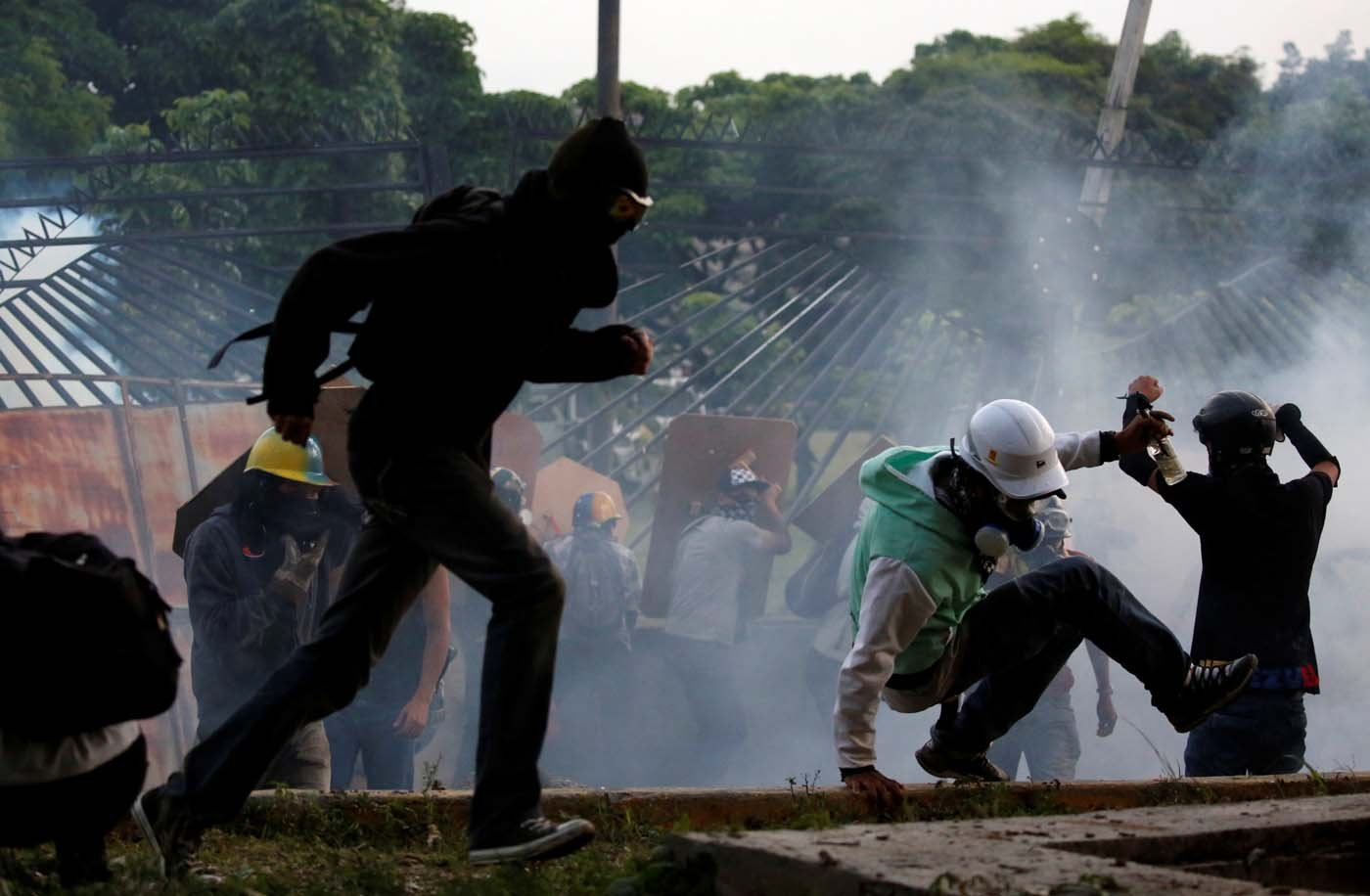 Military police take position at an air base as opposition supporters clash with them while rallying against President Nicolas Maduro in Caracas, Venezuela, May 8, 2017. REUTERS/Carlos Garcia Rawlins
