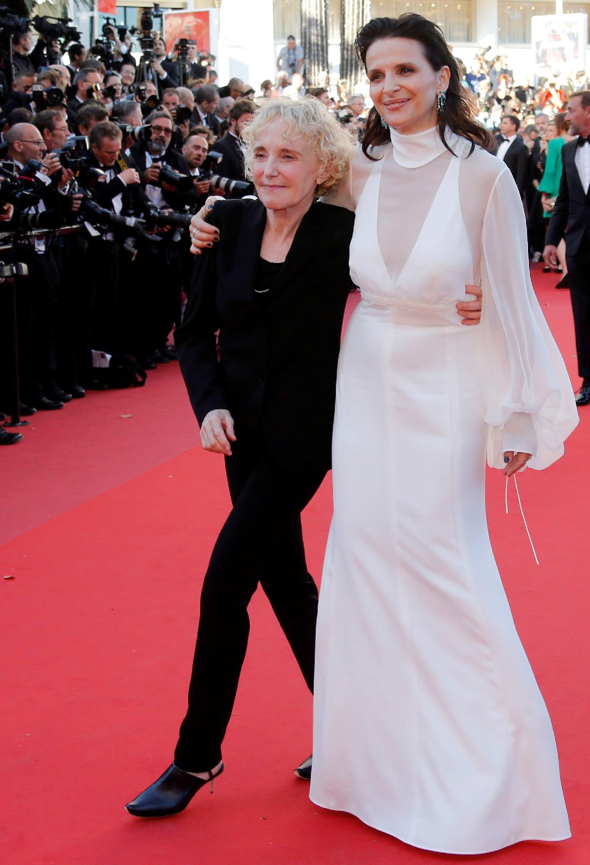 "70th Cannes Film Festival - Screening of the film ""Okja"" in competition - Red Carpet Arrivals- Cannes, France. 19/05/2017. Actress Juliette Binoche and Director Claire Denis poses. REUTERS/Regis Duvignau"