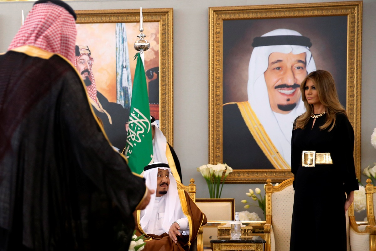 U.S. first lady Melania Trump (R) takes her seat next to Saudi Arabia's King Salman bin Abdulaziz Al Saud (seated-L) as he welcomes her and U.S. President Donald Trump (not pictured) with a coffee ceremony in the Royal Terminal after they arrived aboard Air Force One at King Khalid International Airport in Riyadh, Saudi Arabia May 20, 2017. REUTERS/Jonathan Ernst