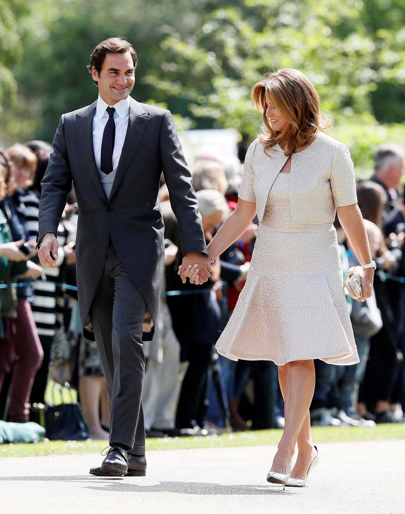 Swiss tennis player Roger Federer and his wife Mirka attend the wedding of Pippa Middleton, the sister of Britain's Catherine, Duchess of Cambridge, and James Matthews at St Mark's Church in Englefield, west of London, on May 20, 2017. REUTERS/Kirsty Wigglesworth/Pool