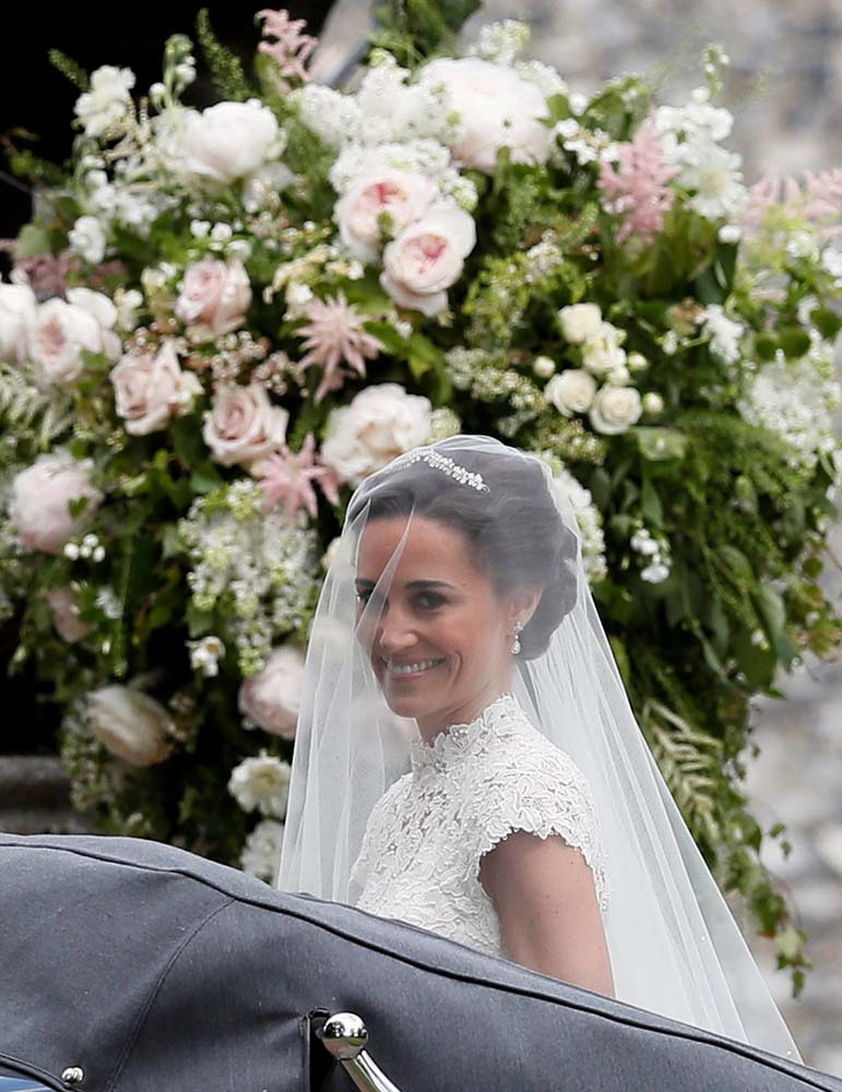 Pippa Middleton, the sister of Britain's Catherine, Duchess of Cambridge, arrives for her wedding to James Matthews at St Mark's Church in Englefield, west of London, on May 20, 2017. REUTERS/Kirsty Wigglesworth/Pool