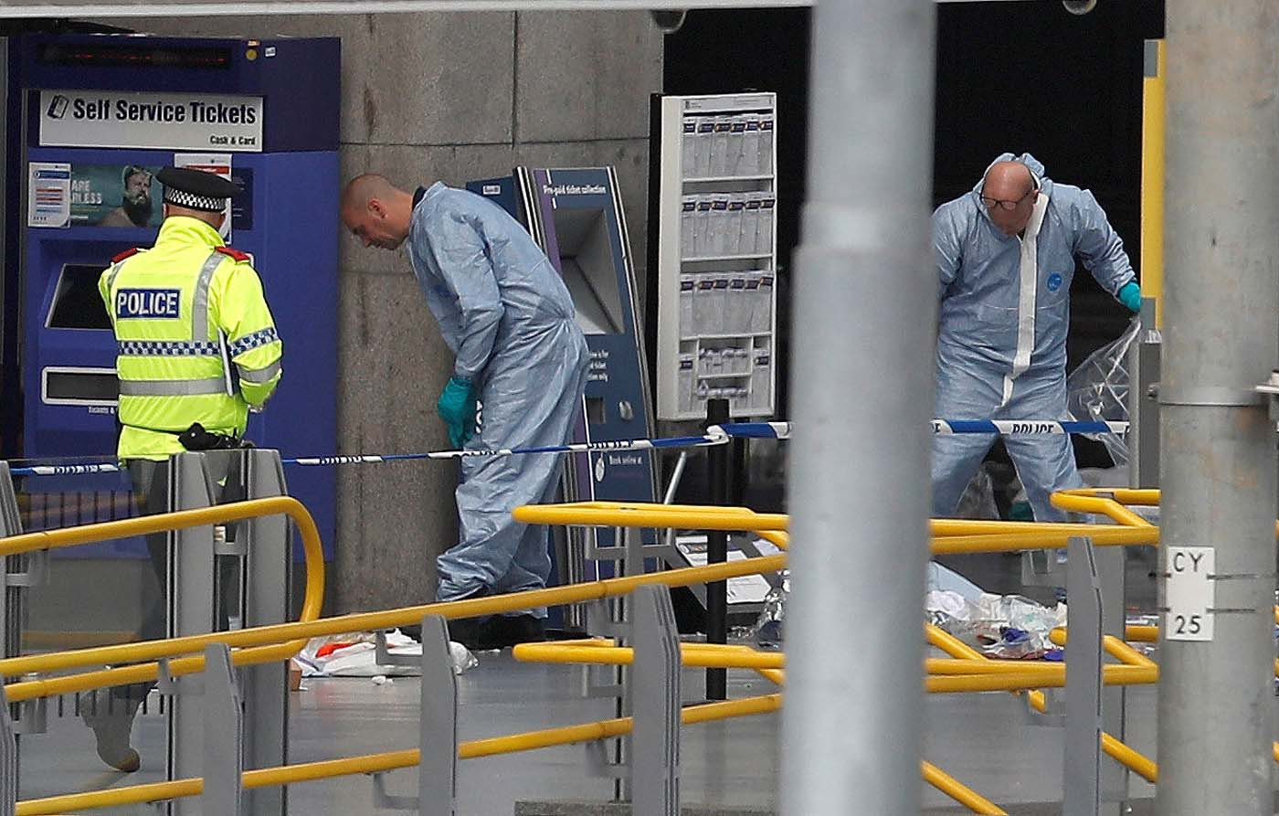 Forensics investigators work at the Manchester Arena in Manchester, Britain May 23, 2017. REUTERS/Darren Staples