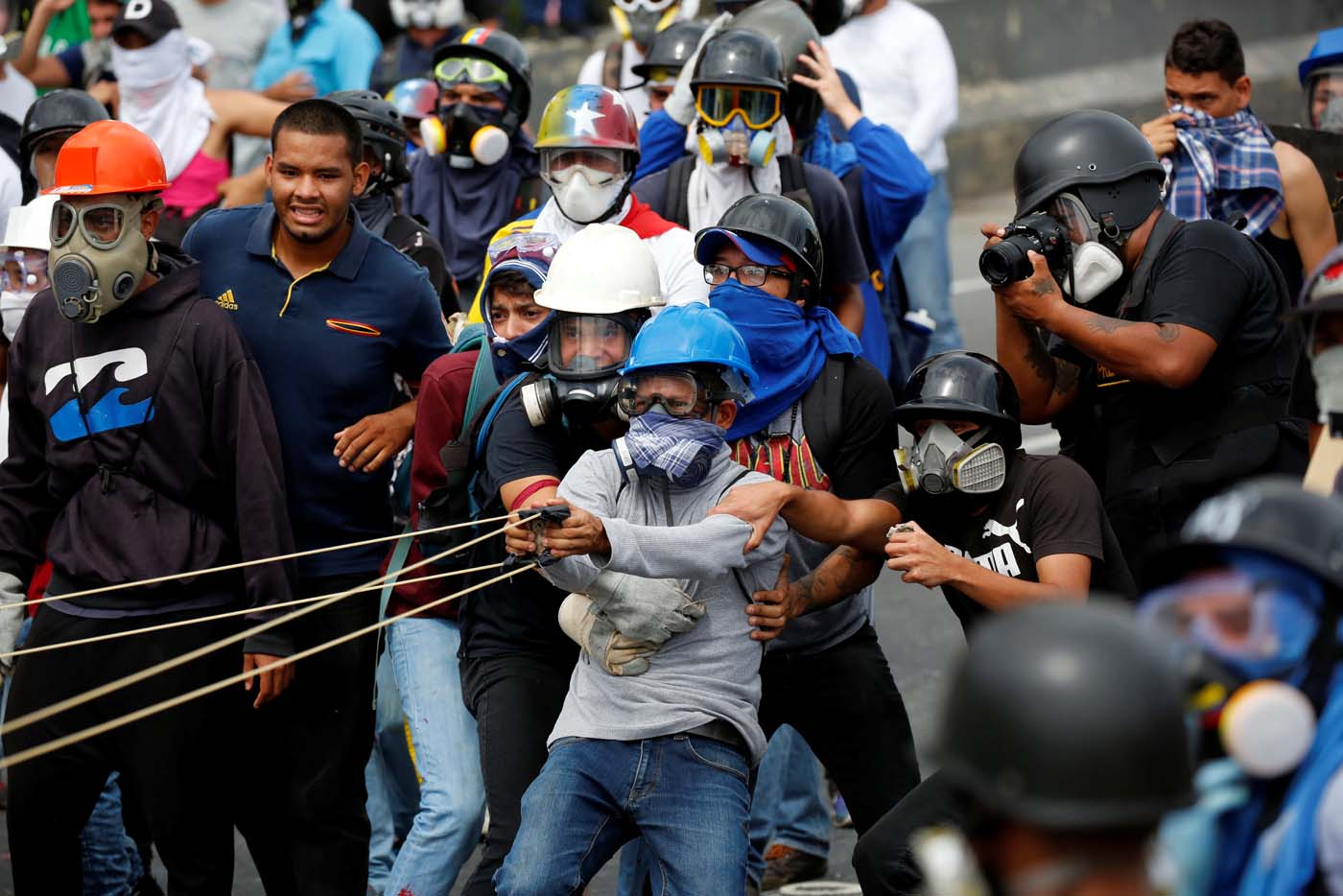 Demonstrators use a giant sling shot while clashing with riot security forces during a rally against President Nicolas Maduro in Caracas, Venezuela, May 24, 2017. REUTERS/Carlos Garcia Rawlins