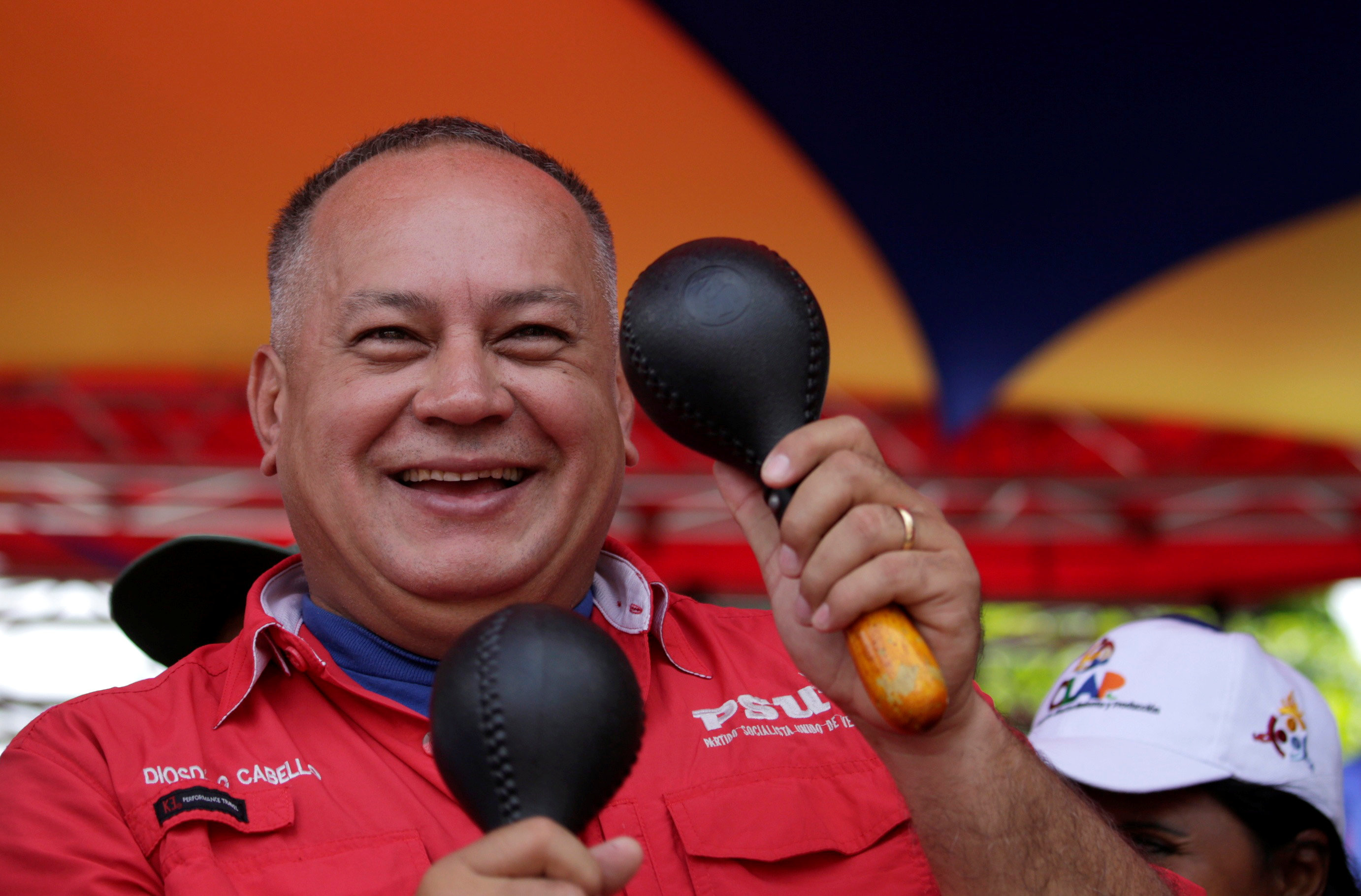Deputy of Venezuela's United Socialist Party Diosdado Cabello plays the maracas during a rally of supporters of Venezuela's President Nicolas Maduro in support of the National Constituent Assembly in Caracas,Venezuela May 31, 2017. REUTERS/Marco Bello