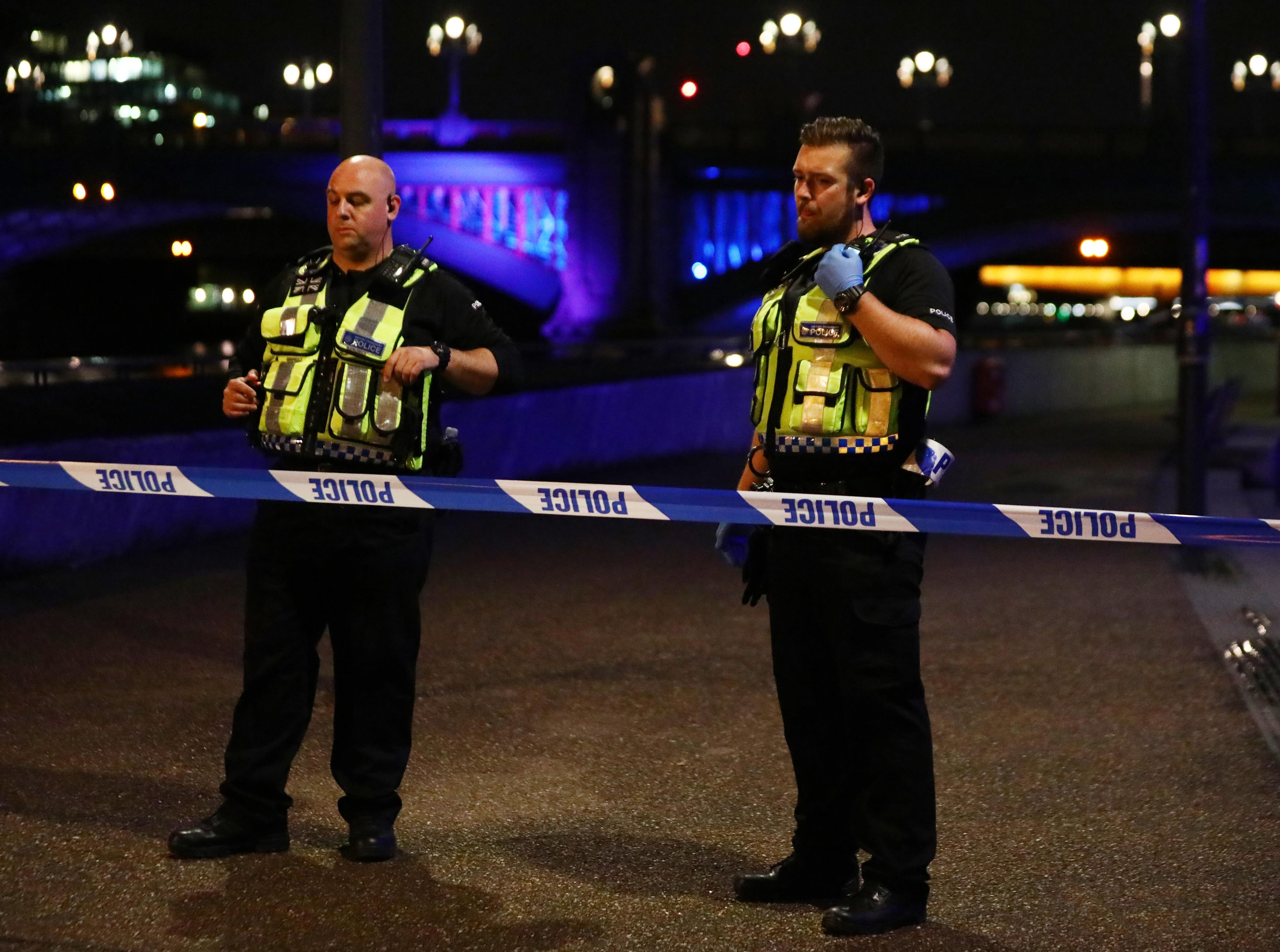 Police officers guard a cordon after an incident near London Bridge in London, Britain June 4, 2017. REUTERS/Neil Hall