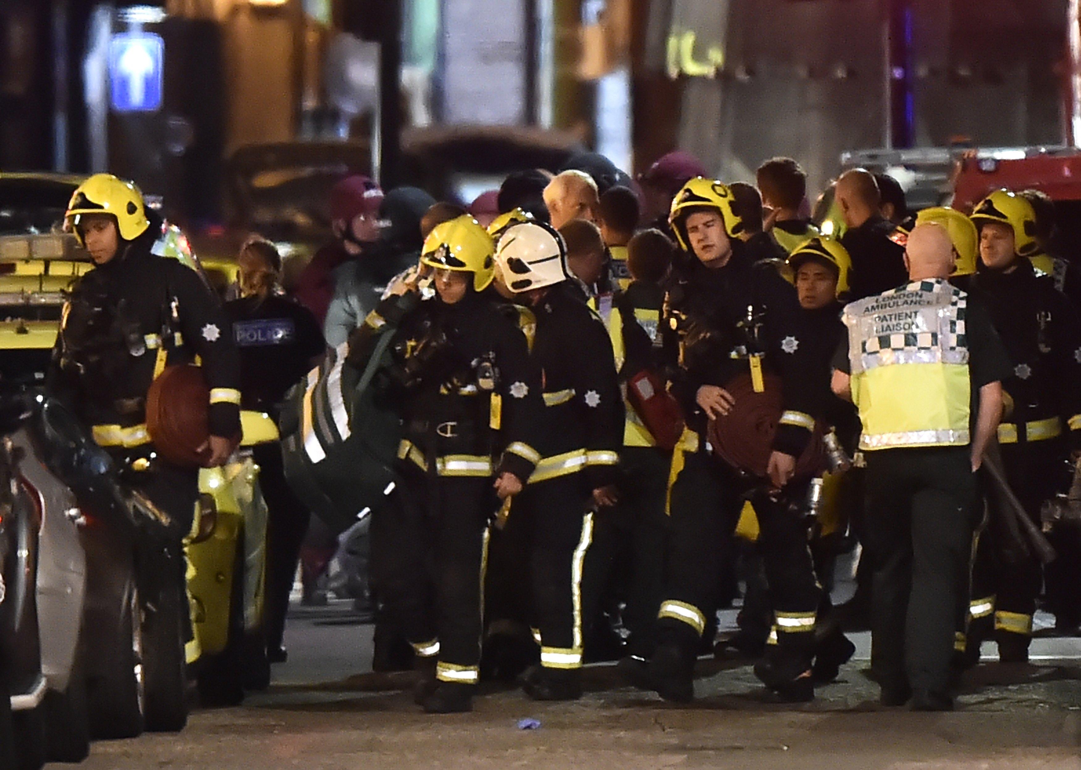 Rescue personnel assemble after an incident near London Bridge in London, Britain June 4, 2017. REUTERS/Hannah Mckay