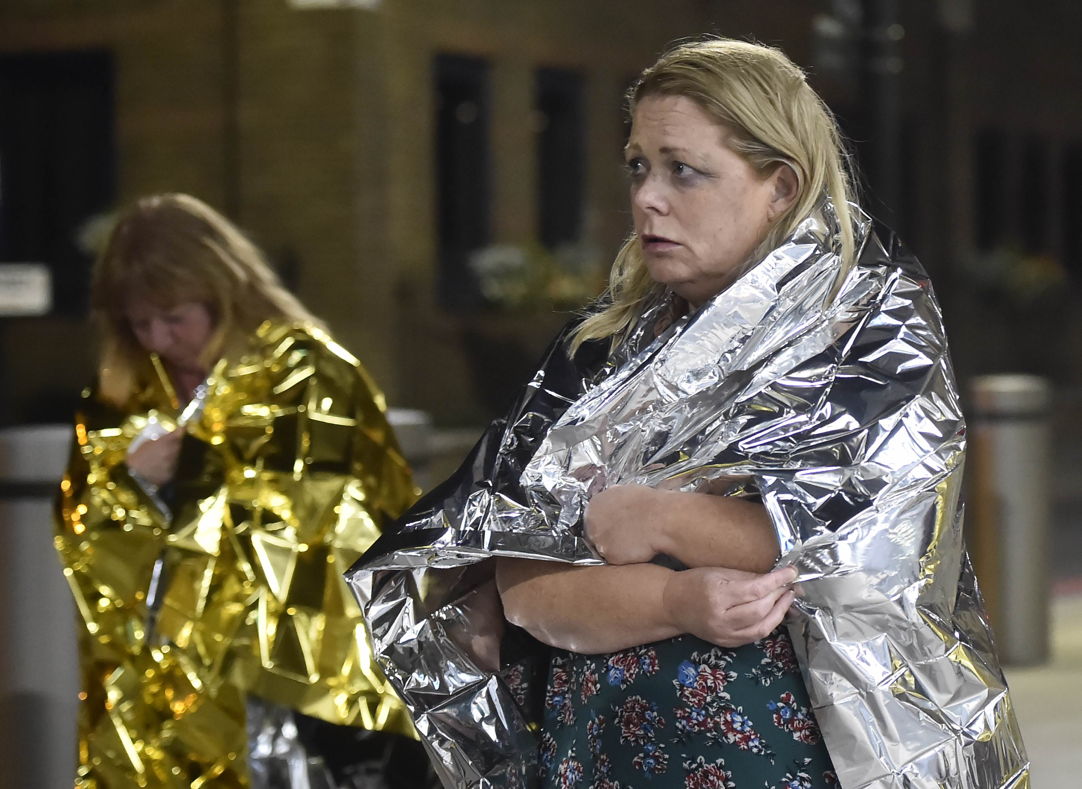 People leave the area wearing foil blankets after an incident near London Bridge in London, Britain June 4, 2017. REUTERS/Hannah Mckay TPX IMAGES OF THE DAY