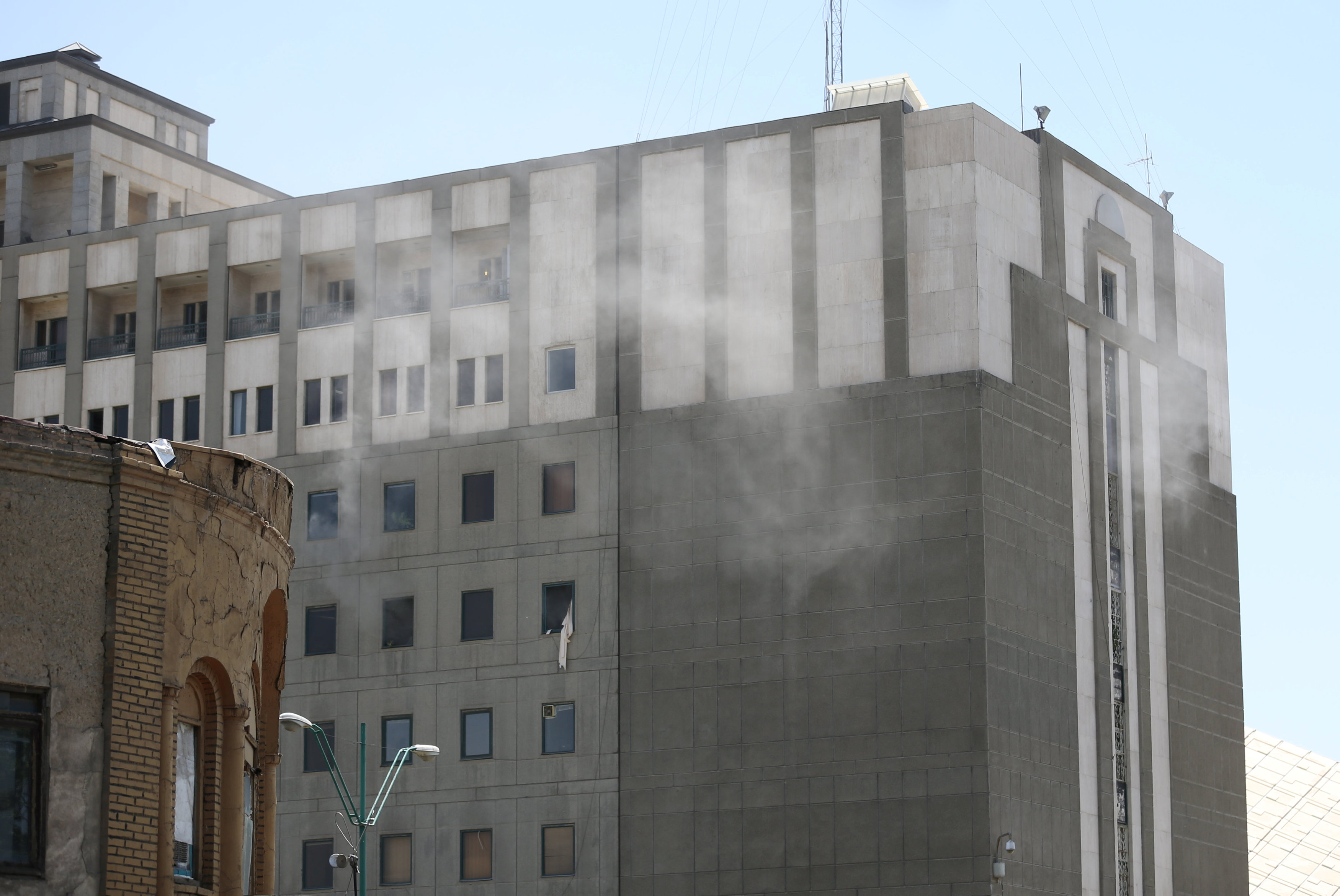Smoke is seen during an attack on the Iranian parliament in central Tehran, Iran, June 7, 2017. Omid Vahabzadeh/TIMA via REUTERS ATTENTION EDITORS - THIS IMAGE WAS PROVIDED BY A THIRD PARTY. FOR EDITORIAL USE ONLY.