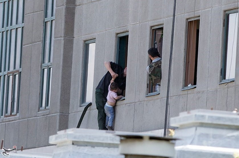 A boy is evacuated during an attack on the Iranian parliament in central Tehran, Iran, June 7, 2017. Tasnim News Agency/Handout via REUTERS ATTENTION EDITORS - THIS PICTURE WAS PROVIDED BY A THIRD PARTY. FOR EDITORIAL USE ONLY. NO RESALES. NO ARCHIVE.