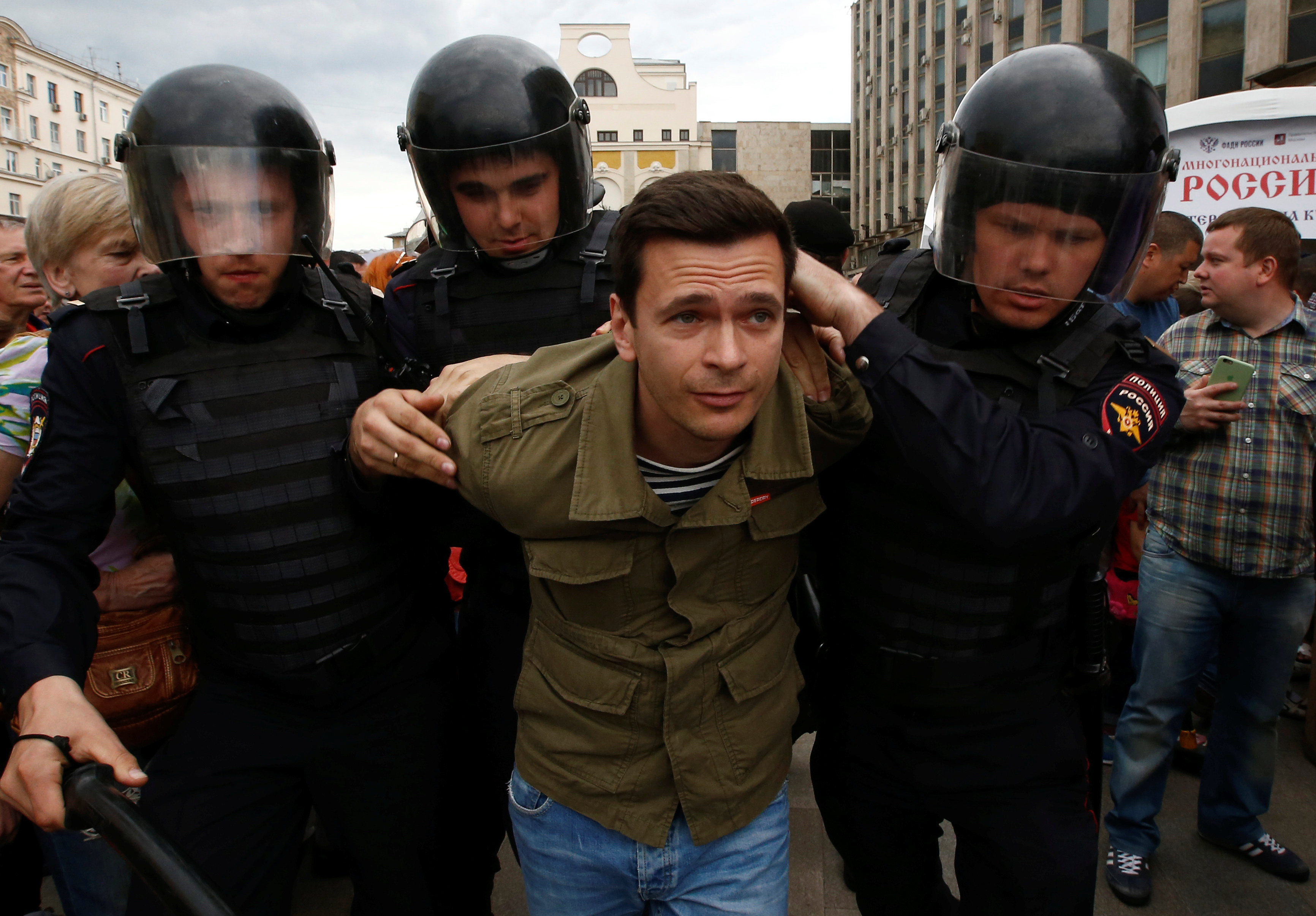Riot police detain Russian opposition figure Ilya Yashin during an anti-corruption protest organised by opposition leader Alexei Navalny, in central Moscow, Russia, June 12, 2017. REUTERS/Sergei Karpukhin