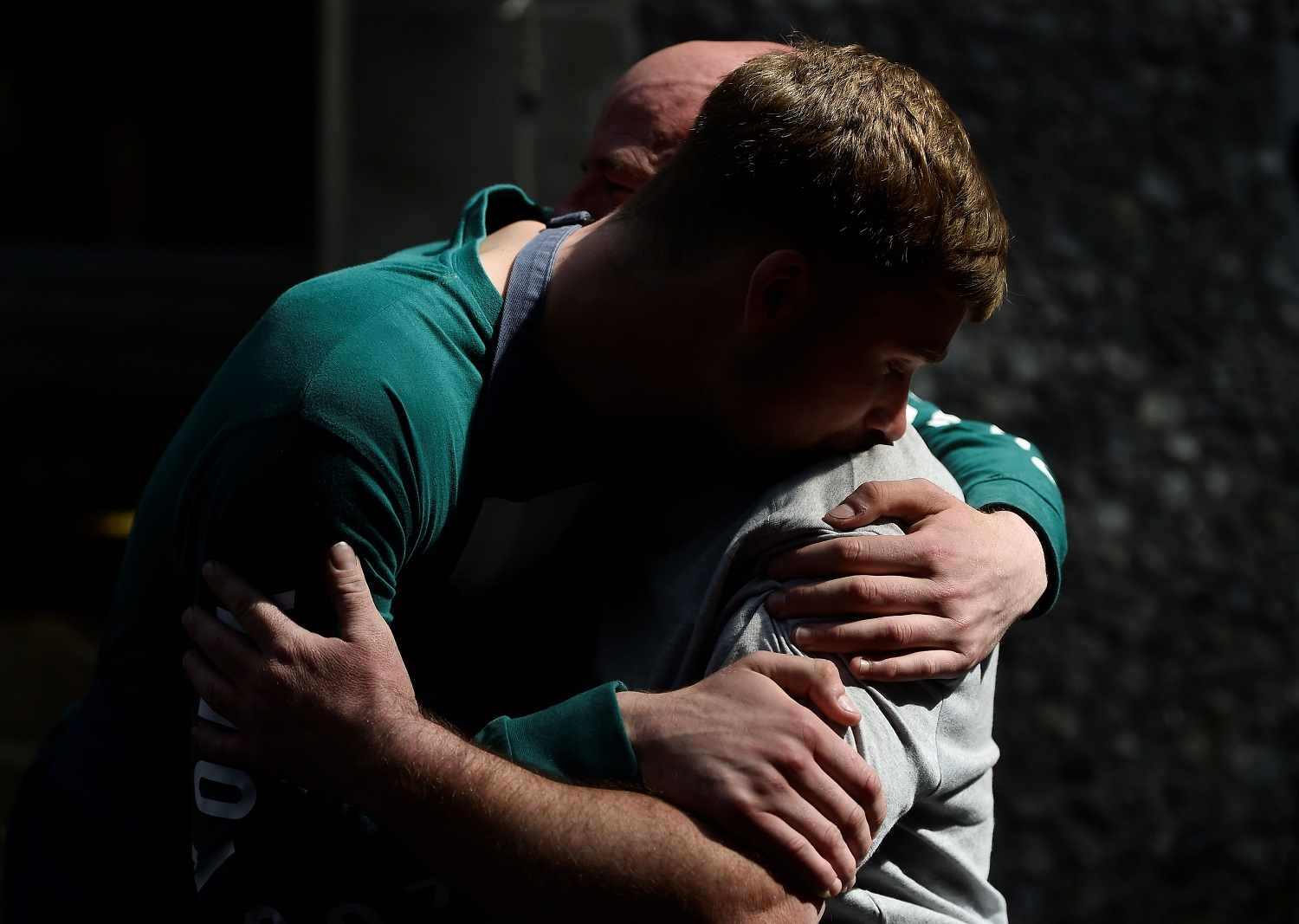 People embrace in Borough Market, which officially re-opened today following the recent attack, in central London, Britain June 14, 2017. REUTERS/Hannah McKay
