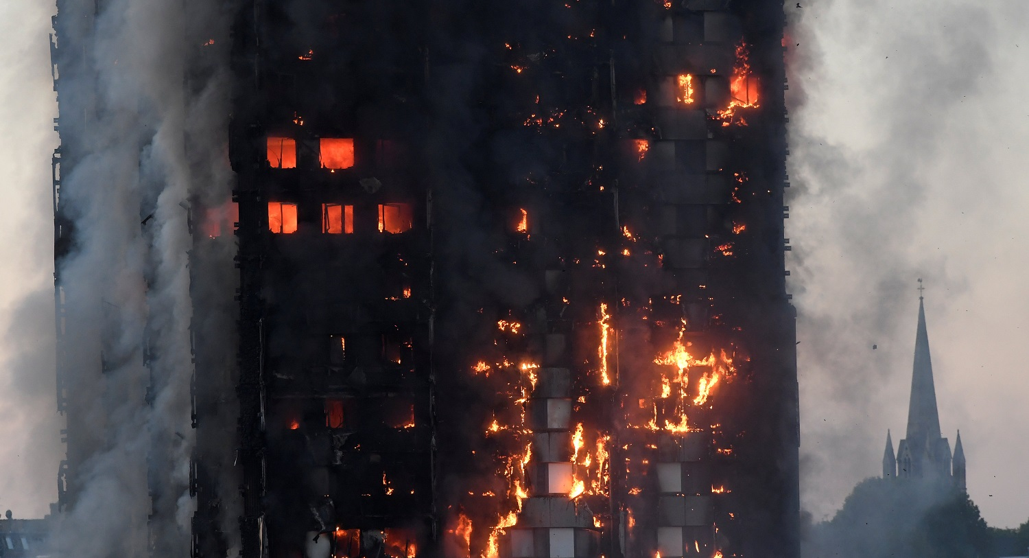 Flames and smoke engulf a tower block, in north Kensington, West London, Britain June 14, 2017. REUTERS/Toby Melville