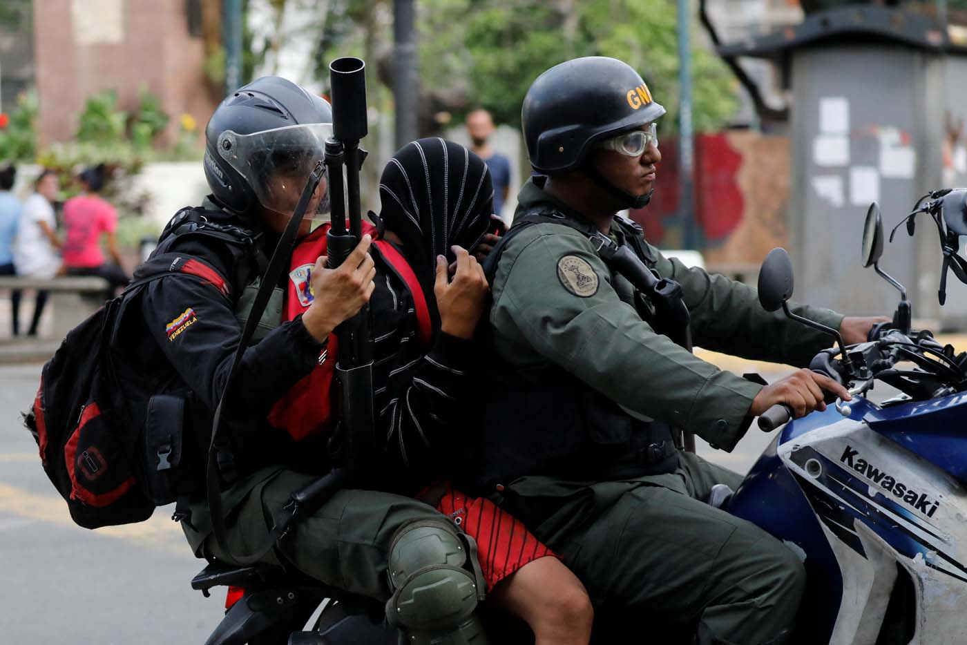 A demonstrator is detained by riot security forces during a protest against Venezuela's President Nicolas Maduro's government in Caracas, Venezuela June 14, 2017. REUTERS/Carlos Garcia Rawlins