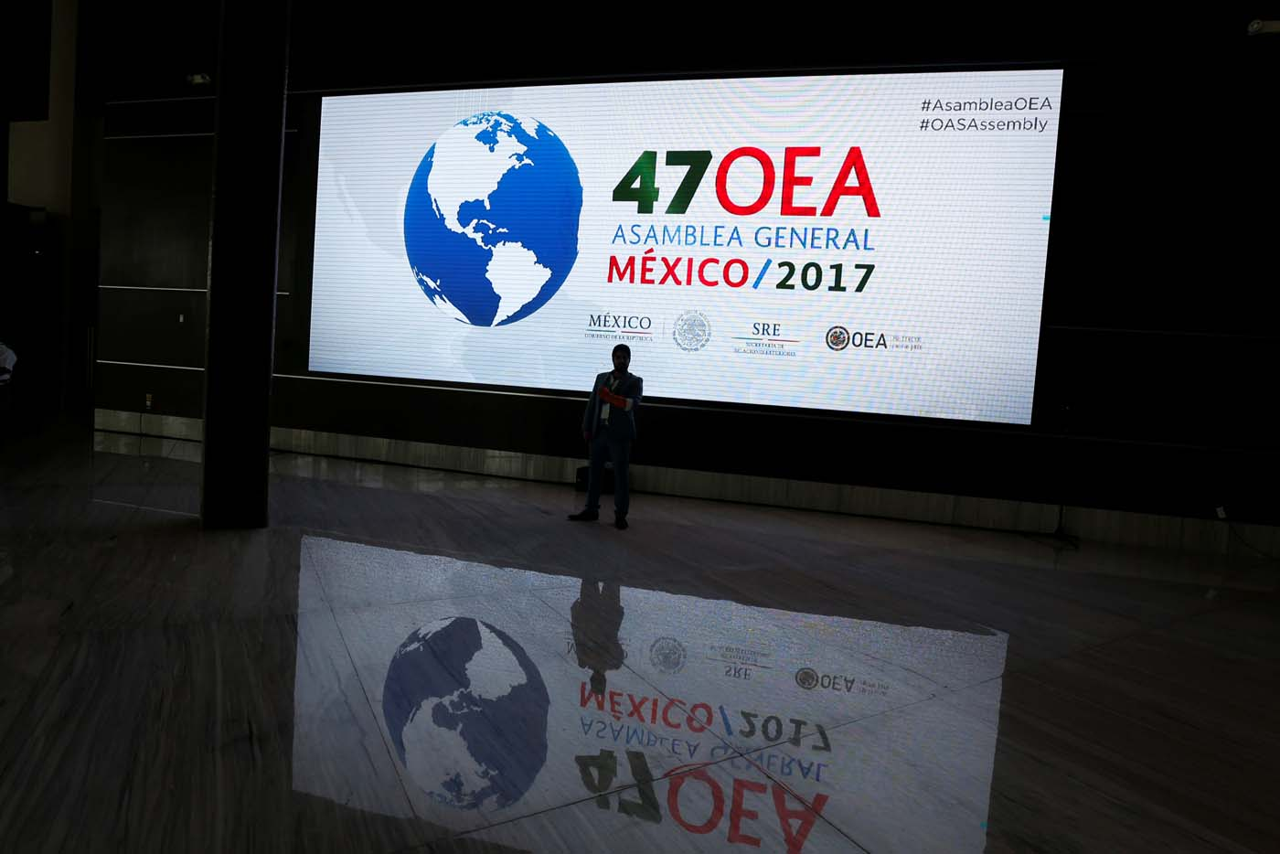 A screen with the logo of The Organization of American States is pictured where the where the 47th General Assembly will take place in Cancun, Mexico June 18, 2017. REUTERS/Carlos Jasso