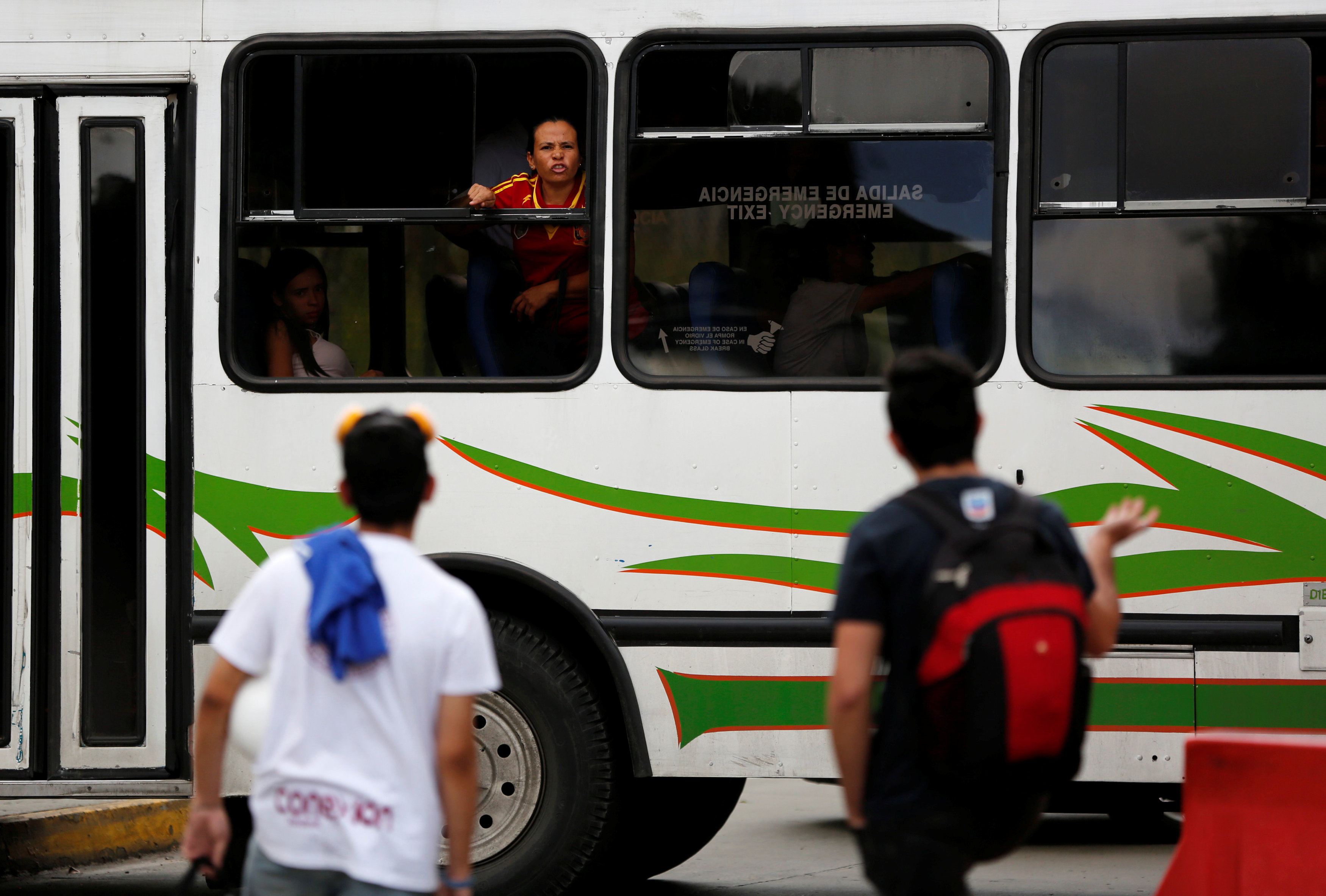 A female passenger on a bus argues with opposition supporters blocking a street during a rally against Venezuela's President Nicolas Maduro's Government in Caracas, Venezuela, June 30, 2017. REUTERS/Ivan Alvarado
