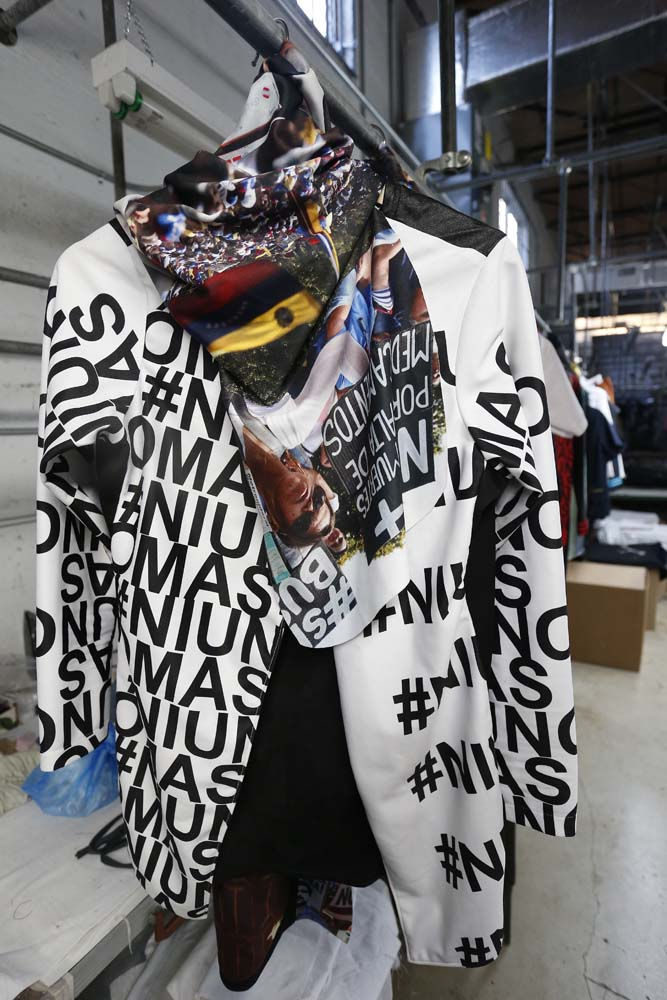 "Venezuelan artist and designer Lisu Vega's collection ""Resistance"" is shown in a warehouse in Miami, Florida on June 8, 2017. The models are dressed in scenes of violence in Caracas and handkerchiefs representing the rags used by protesters to protect themselves from police tear gas. It is the ""Resistance"" collection of Venezuelan fashion designer Lisu Vega. / AFP PHOTO / RHONA WISE"