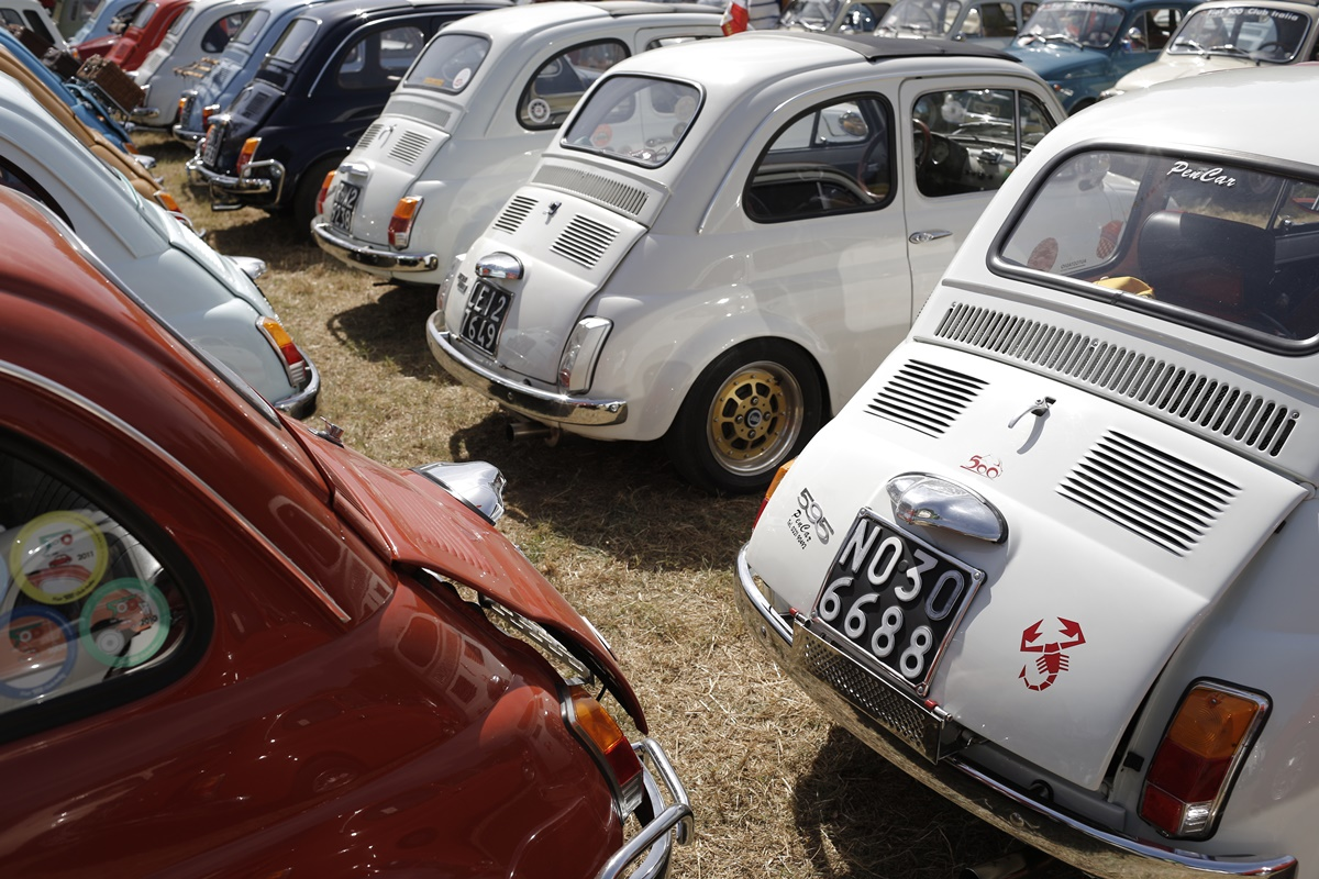 The cars of participants are parked during the 34th International Rally of Fiat 500 Club Italia for the 60th anniversary of this car on July 8, 2017, in Garlenda, near Genoa.   More than 1200 cars came from Europe to take part at the 34 rally of Garlenda to celebrate the 60th anniversary of the Fiat 500.  / AFP PHOTO / Marco BERTORELLO