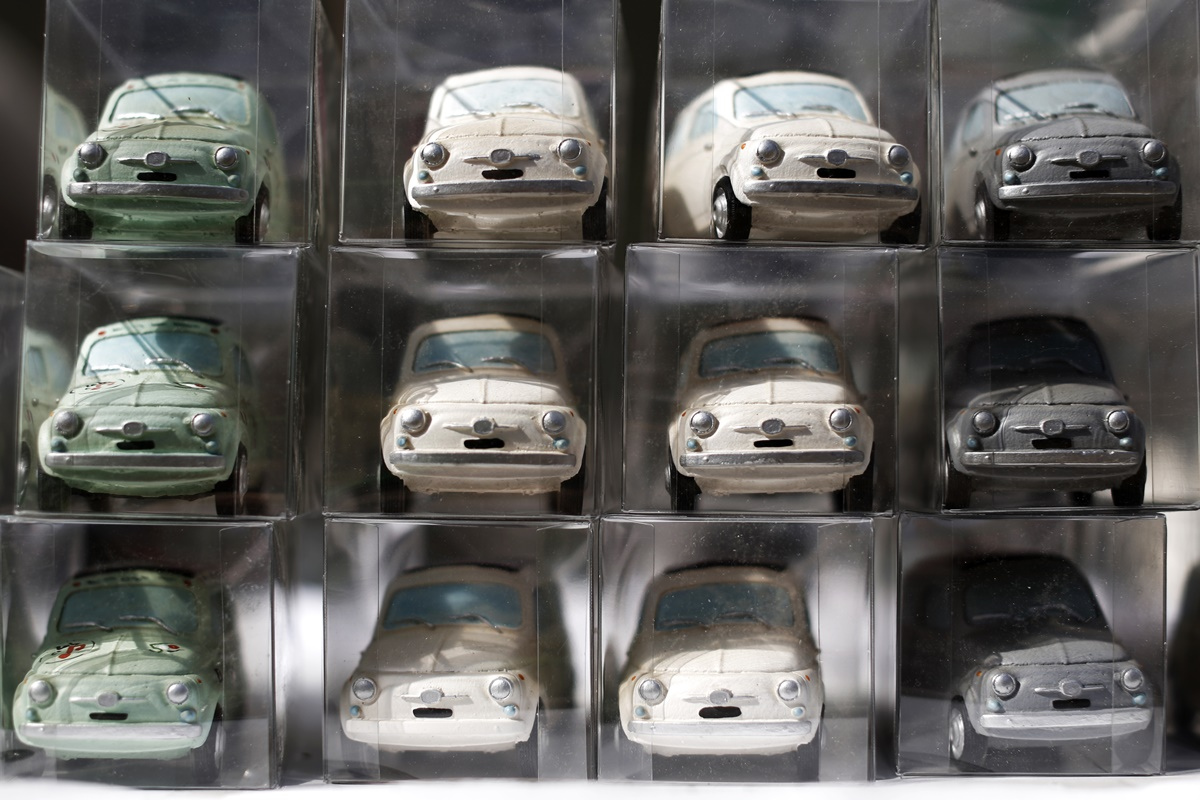 Model cars are displayed during the 34th International Rally of Fiat 500 Club Italia for the 60th anniversary of this car on July 8, 2017, in Garlenda, near Genoa.   More than 1200 cars came from Europe to take part at the 34 rally of Garlenda to celebrate the 60th anniversary of the Fiat 500.  / AFP PHOTO / Marco BERTORELLO