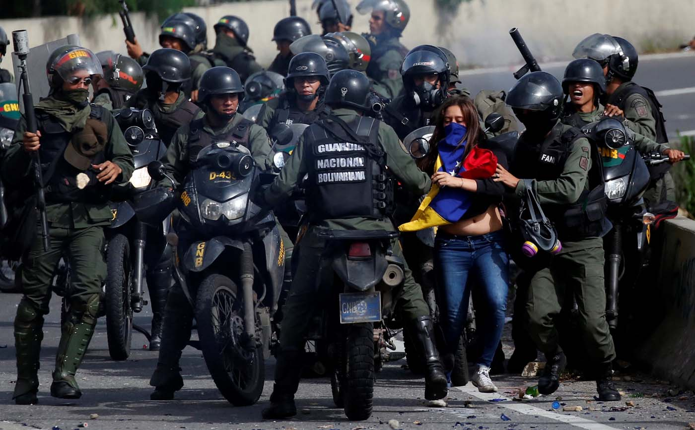A demonstrator is detained by security forces during clashes at a protest against Venezuelan President Nicolas Maduro's government in Caracas, Venezuela, July 10, 2017. REUTERS/Carlos Garcia Rawlins
