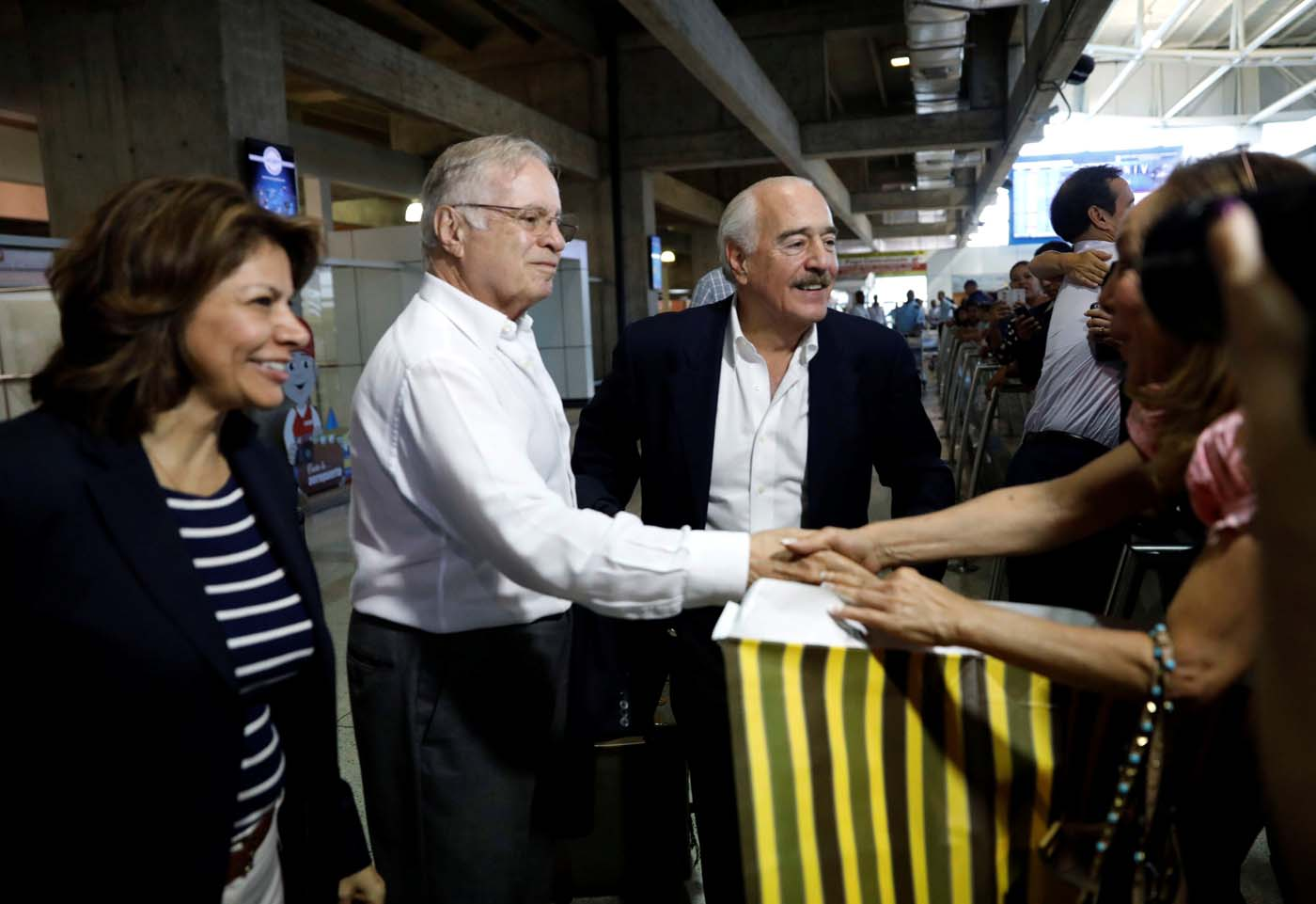 The former presidents of Costa Rica Laura Chinchilla and Miguel Angel Rodriguez and Colombia's former president Andres Pastrana arrive at Caracas airport ahead of an unofficial referendum called by the opposition in Venezuela July 15, 2017. REUTERS/Andres Martinez Casares