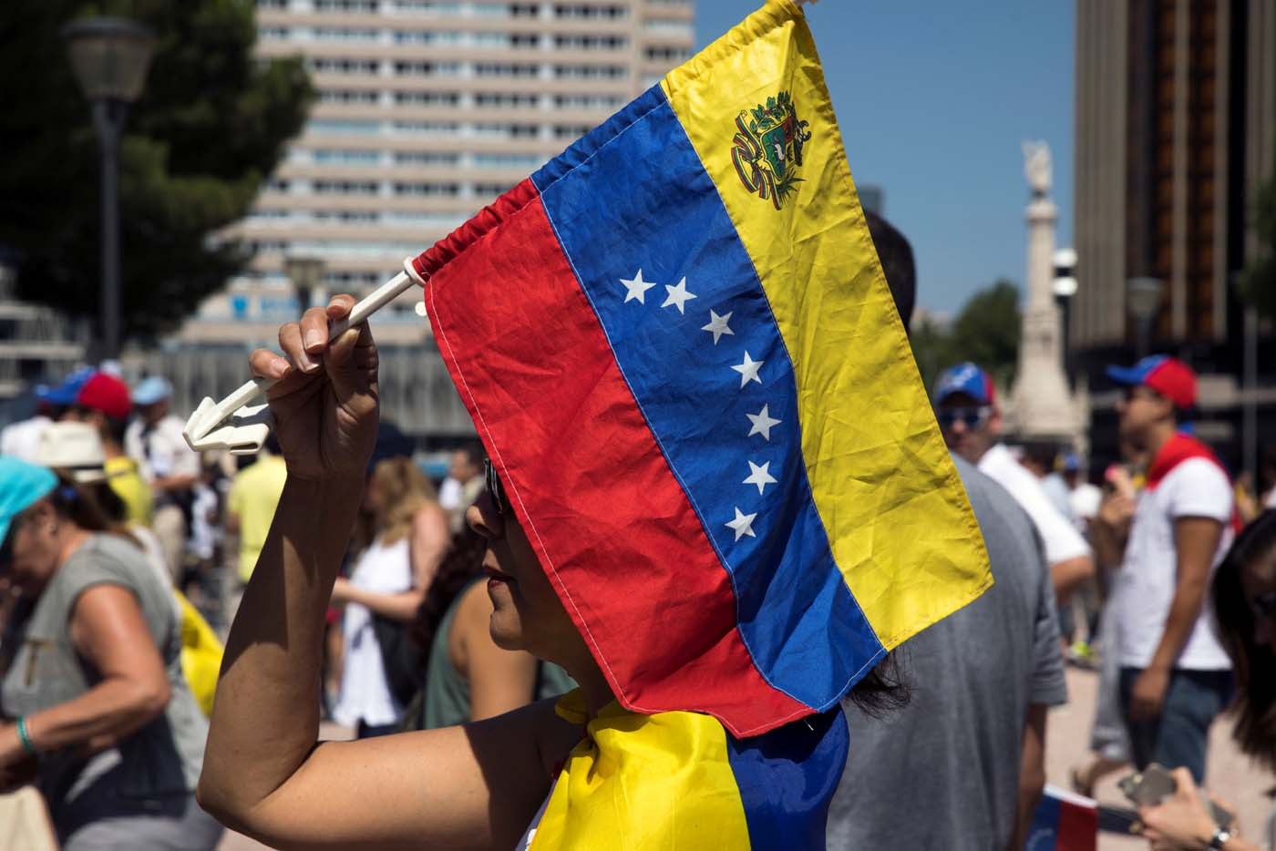 A woman holds a Venezuelan national flag during an unofficial plebiscite against Venezuela's President Nicolas Maduro's government in Madrid, Spain, July 16, 2017. REUTERS/Juan Medina
