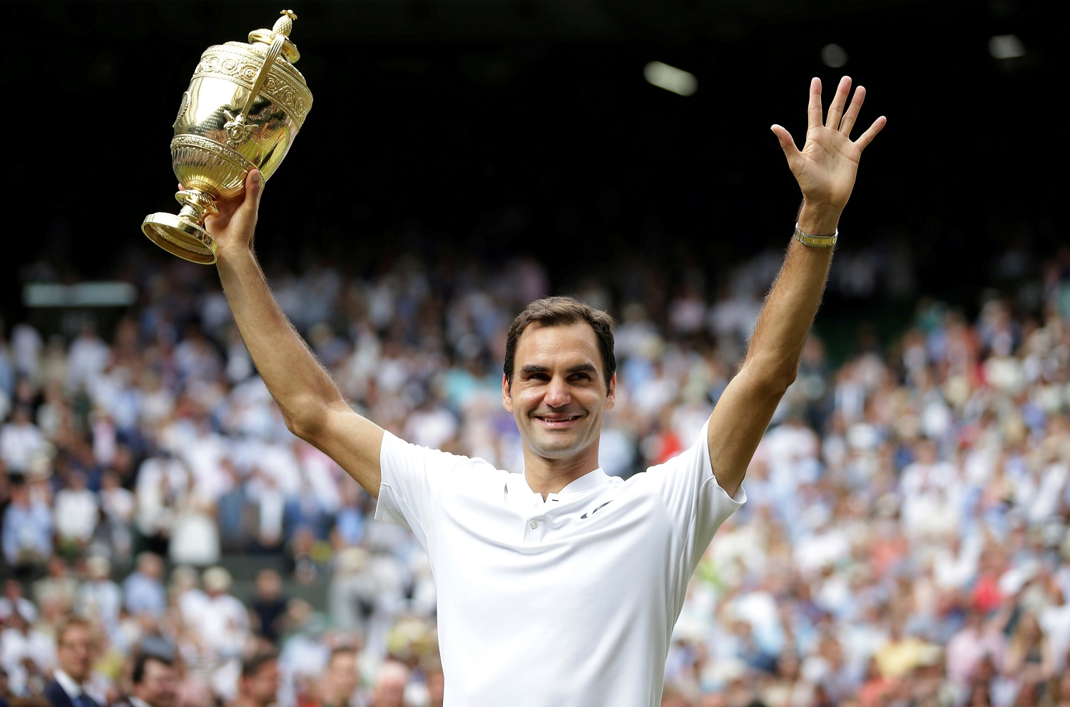 Tennis - Wimbledon - London, Britain - July 16, 2017 Switzerland's Roger Federer poses with the trophy as he celebrates winning the final against Croatia's Marin Cilic REUTERS/Daniel Leal-Olivas/Pool TPX IMAGES OF THE DAY