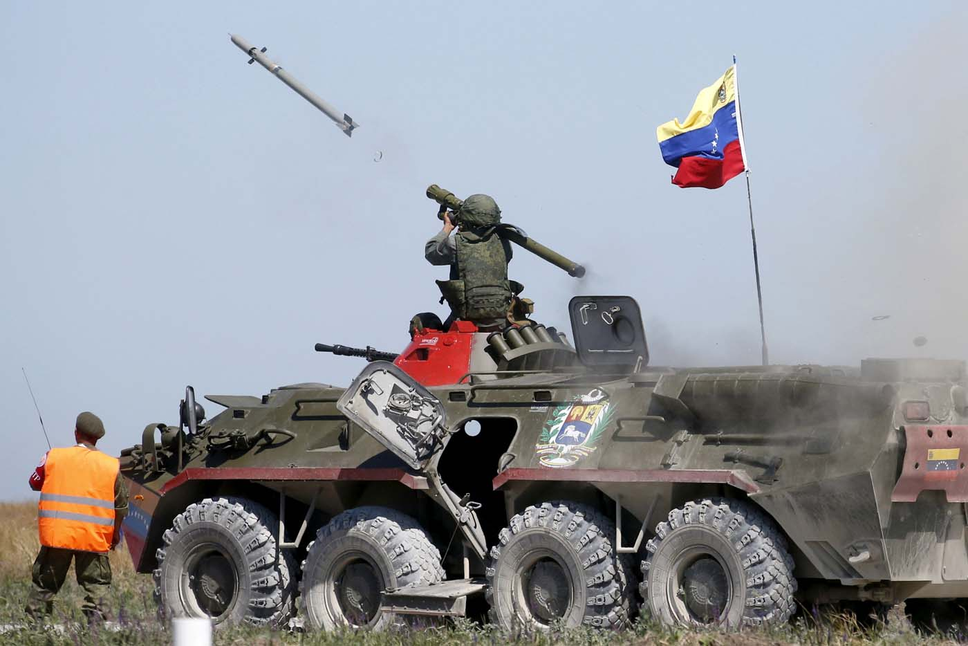 FILE PHOTO: A serviceman from Venezuela fires an anti-aircraft missile with a Russian-made Igla ground-to-air launcher as he sits on top of an armoured personnel carrier (APC) during the Air defense battle masters competition as part of the International Army Games 2015 in the port town of Yeysk, Russia, August 9, 2015. REUTERS/Maxim Zmeyev/Files