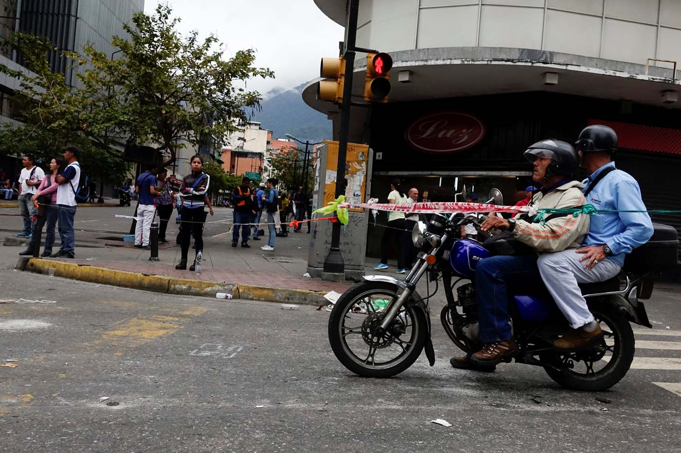 A motorcyclist stops next to ropes used to block the streets during a protest against Venezuelan President Nicolas Maduro's government in Caracas, Venezuela July 19, 2017. REUTERS/Carlos Garcia Rawlins