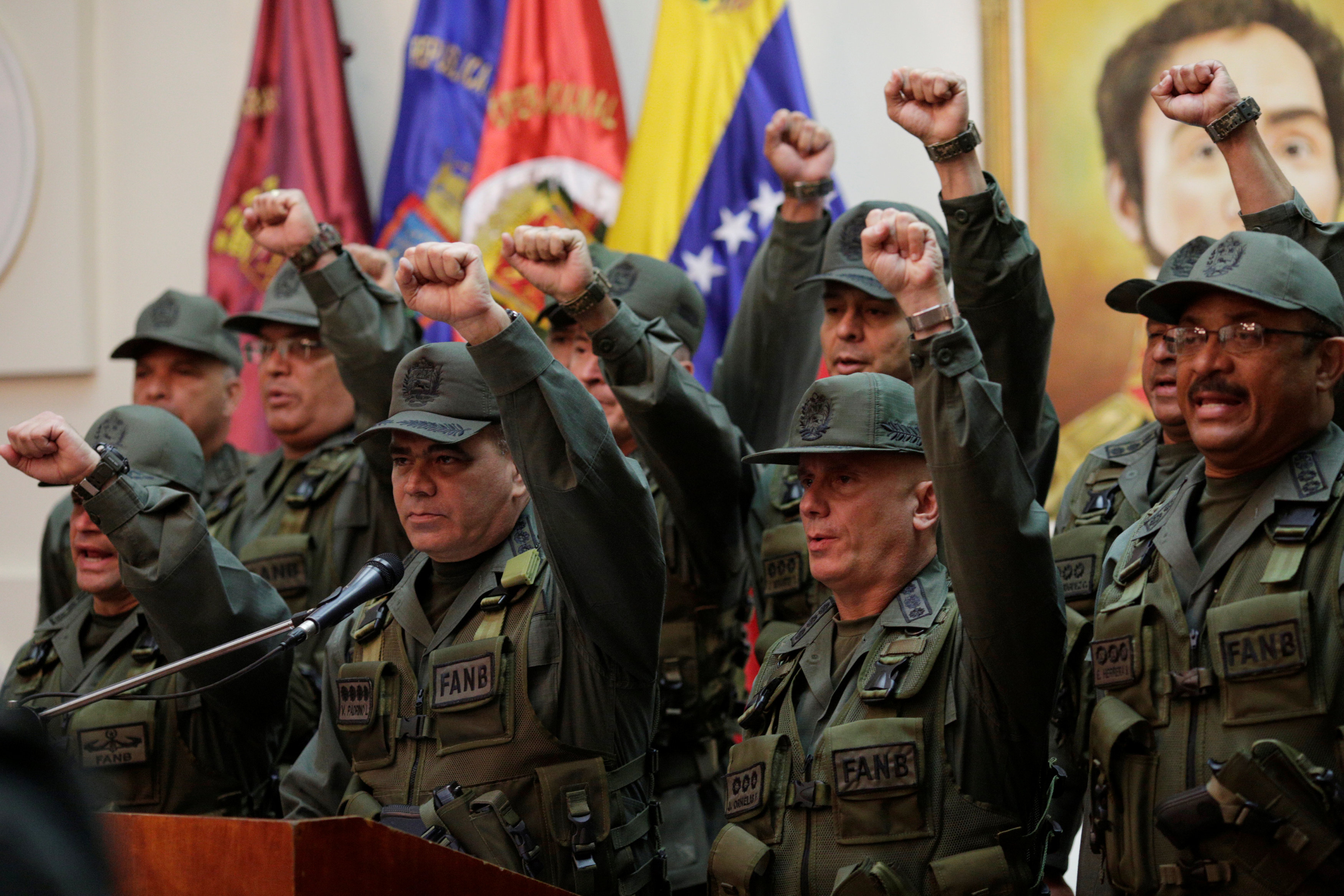 Venezuela's Defense Minister Vladimir Padrino Lopez, accompanied by members of the military high command, attends a news conference in Caracas, Venezuela, July 19, 2017.  REUTERS/Marco Bello