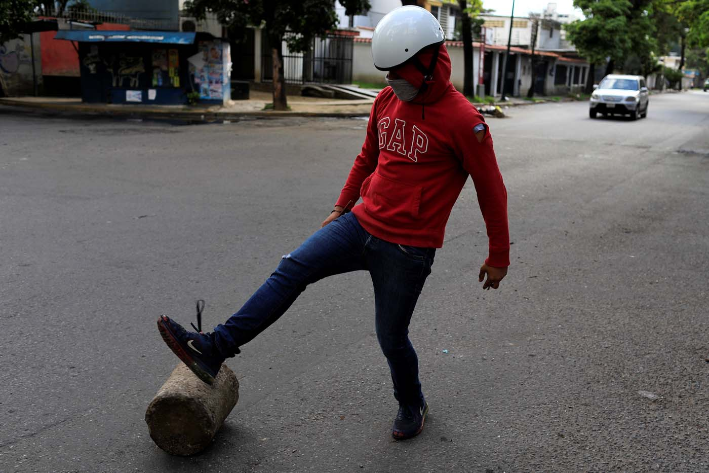 A demonstrator moves a piece of wood to prepare a barricade during a strike called to protest against Venezuelan President Nicolas Maduro's government in Caracas, Venezuela, July 26, 2017. REUTERS/Marco Bello