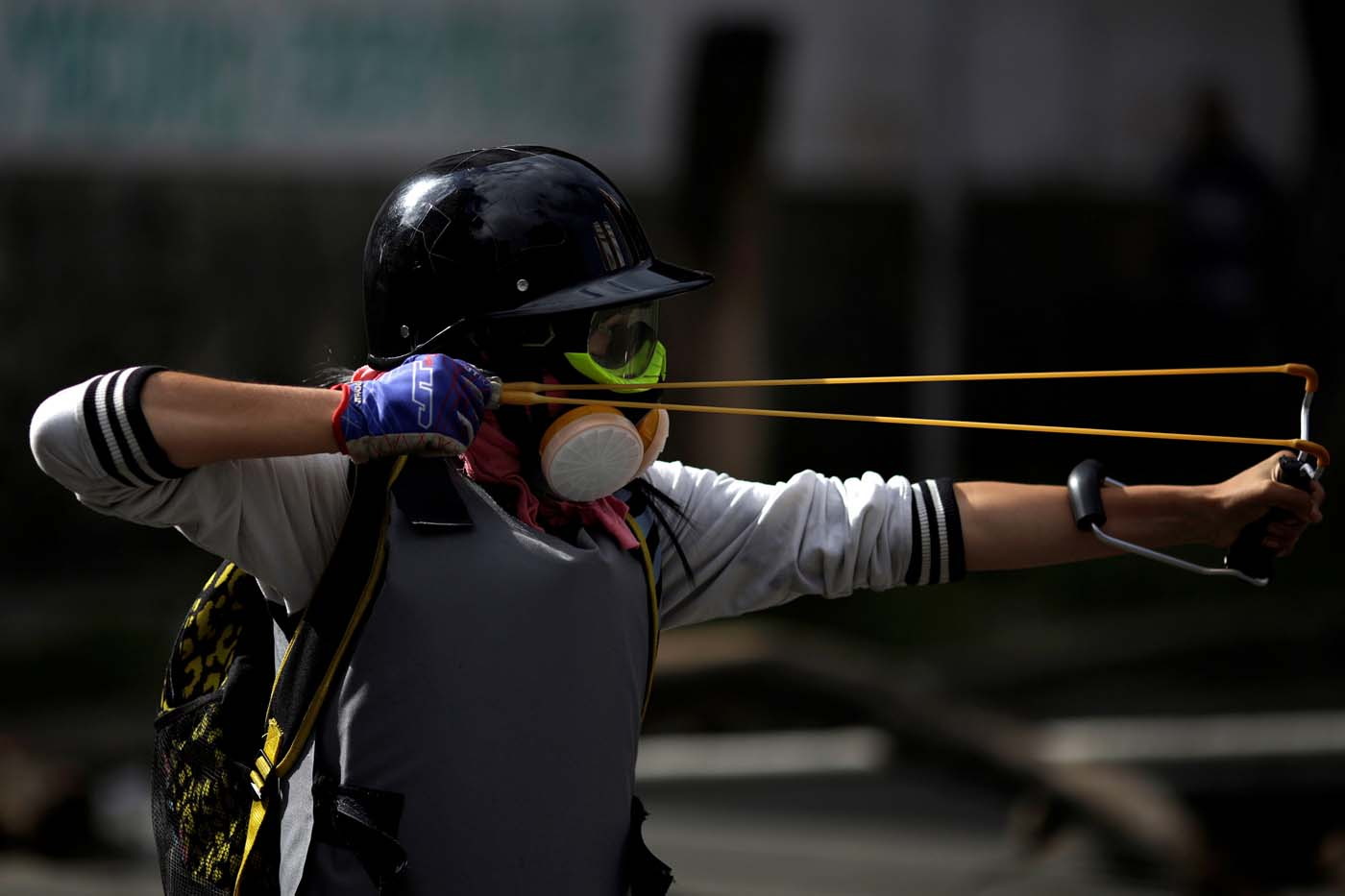 A demonstrator uses a slingshot during a strike called to protest against Venezuelan President Nicolas Maduro's government in Caracas, Venezuela July 26, 2017. REUTERS/Marco Bello