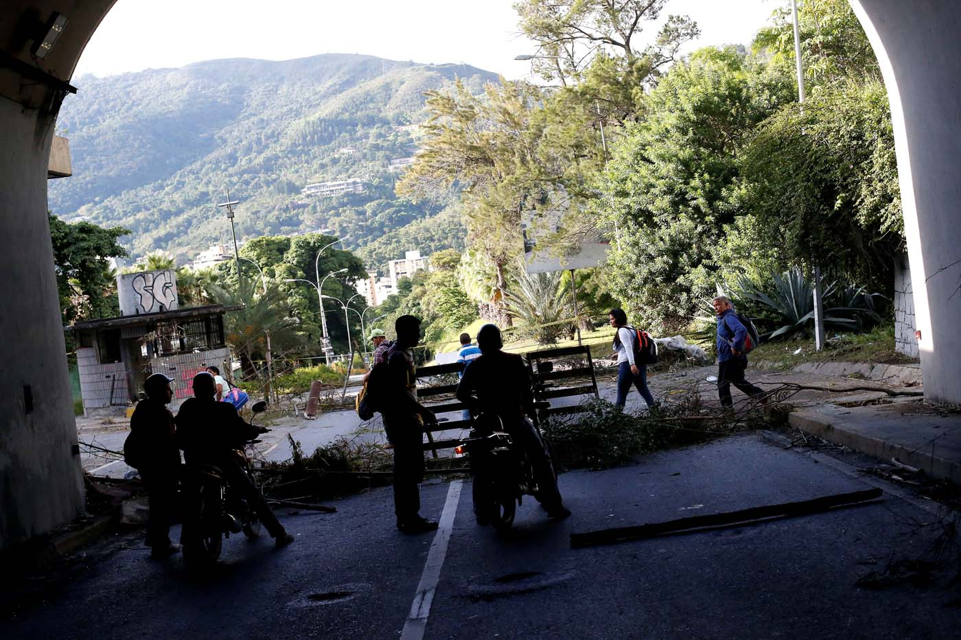 Motorcyclists stand at a blocked road during a strike called to protest against Venezuelan President Nicolas Maduro's government in Caracas, Venezuela July 26, 2017. REUTERS/Andres Martinez Casares