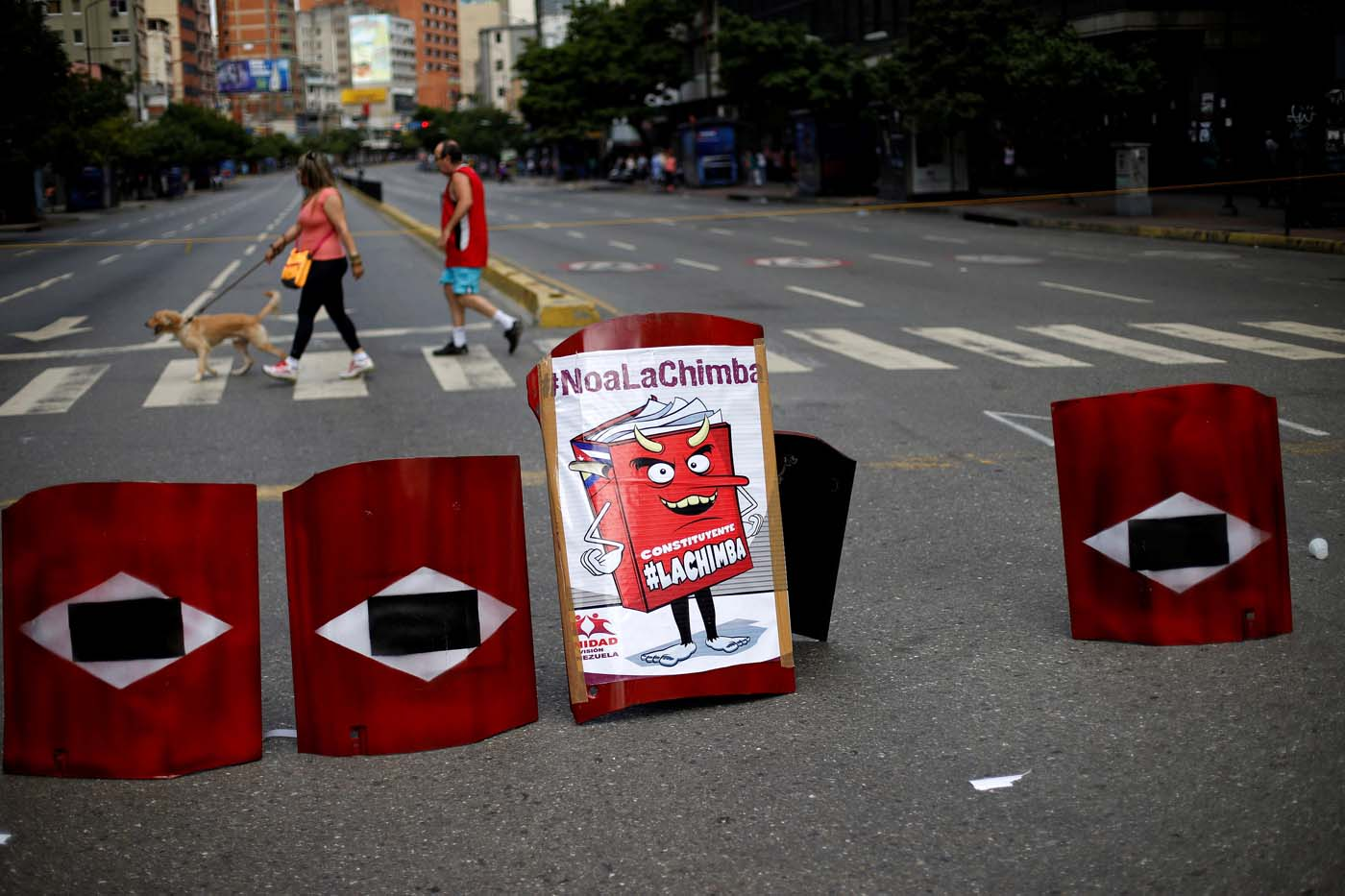 """Makeshift shields lie on a blocked road during a strike called to protest against Venezuelan President Nicolas Maduro's government in Caracas, Venezuela July 26, 2017. On the shield reads """"Constituent"""" REUTERS/Andres Martinez Casares"""