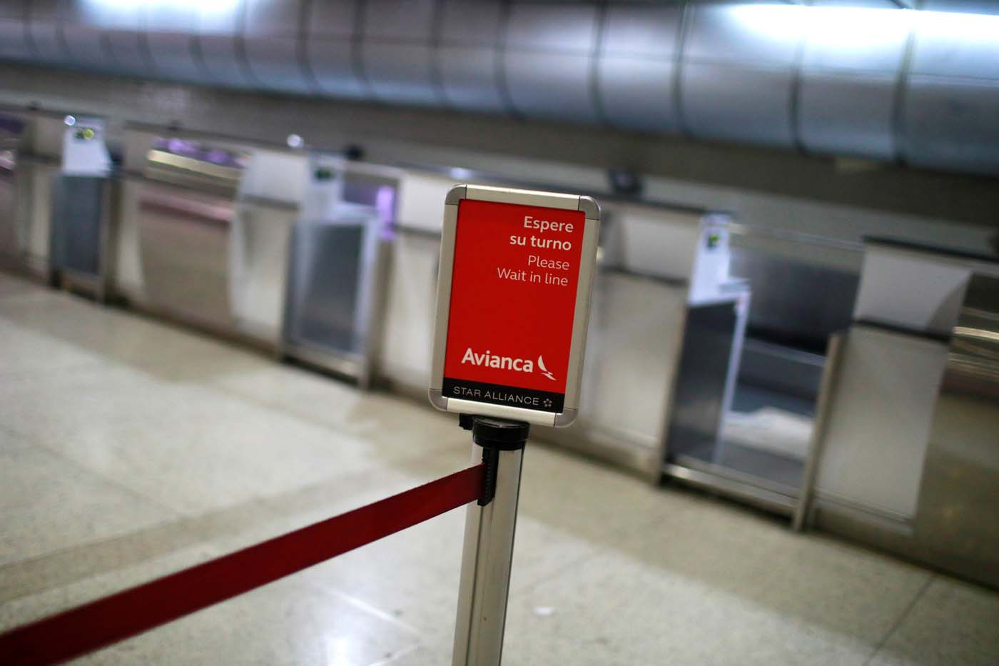 Empty counters of Avianca airline are seen at the Simon Bolivar airport in Caracas, Venezuela July 27, 2017. REUTERS/Marco Bello