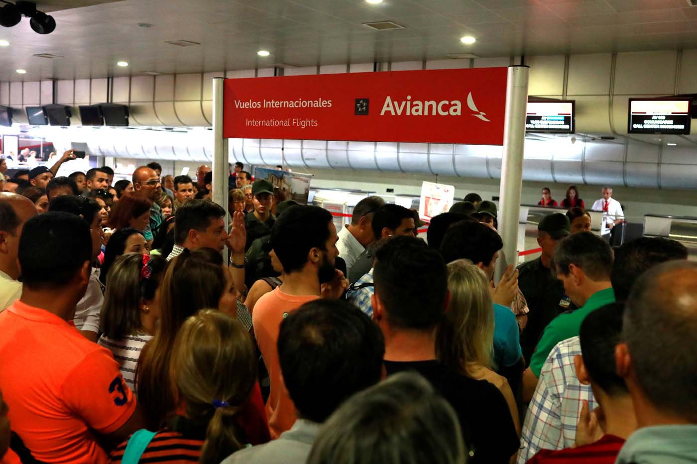 People congregate in front of counters of Avianca airline at the Simon Bolivar airport in Caracas, Venezuela July 27, 2017. REUTERS/Marco Bello