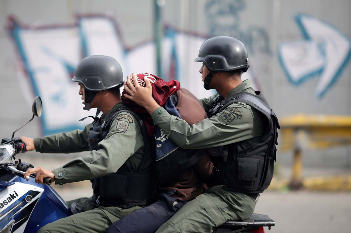 A demonstrator is detained at a rally during a strike called to protest against Venezuelan President Nicolas Maduro's government in Caracas, Venezuela July 27, 2017 . REUTERS/Ueslei Marcelino