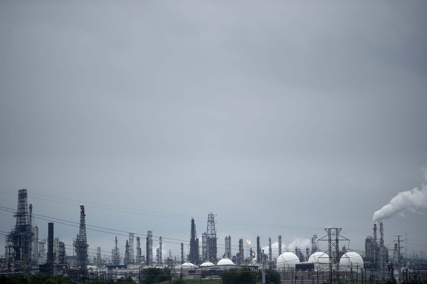 Refineries are seen in the aftermath of Hurricane Harvey August 27, 2017 in Houston, Texas. Hurricane Harvey left a trail of devastation after the most powerful storm to hit the US mainland in over a decade slammed into Texas, destroying homes, severing power supplies and forcing tens of thousands of residents to flee. / AFP PHOTO / Brendan Smialowski