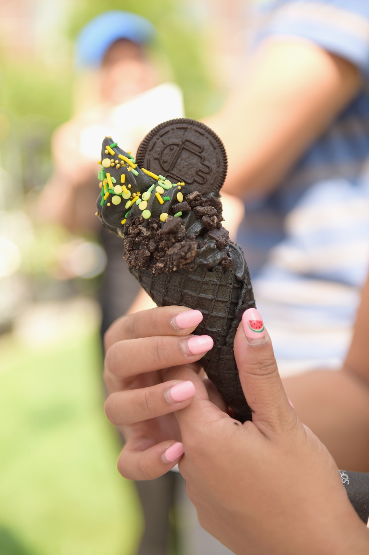 NEW YORK, NY - AUGUST 21: A guest samples a custom Little Damage ice cream flavor as Google and Oreo reveal Android OREO during the solar eclipse at the 14th street park on August 21, 2017 in New York City.   Jason Kempin/Getty Images for Oreo/AFP
