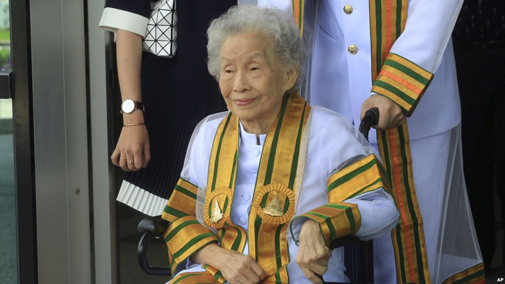 In this Wednesday, Aug. 9, 2017, Kimlun Jinakul 91 year-old sits on cart graduate from Sukhothai Thammathirat Open University before receiving her bachelor's degree from Thailand's King Maha Vajiralongkorn Bodindradebayavarangkun. (AP Photo/Str)**Thailand Out**