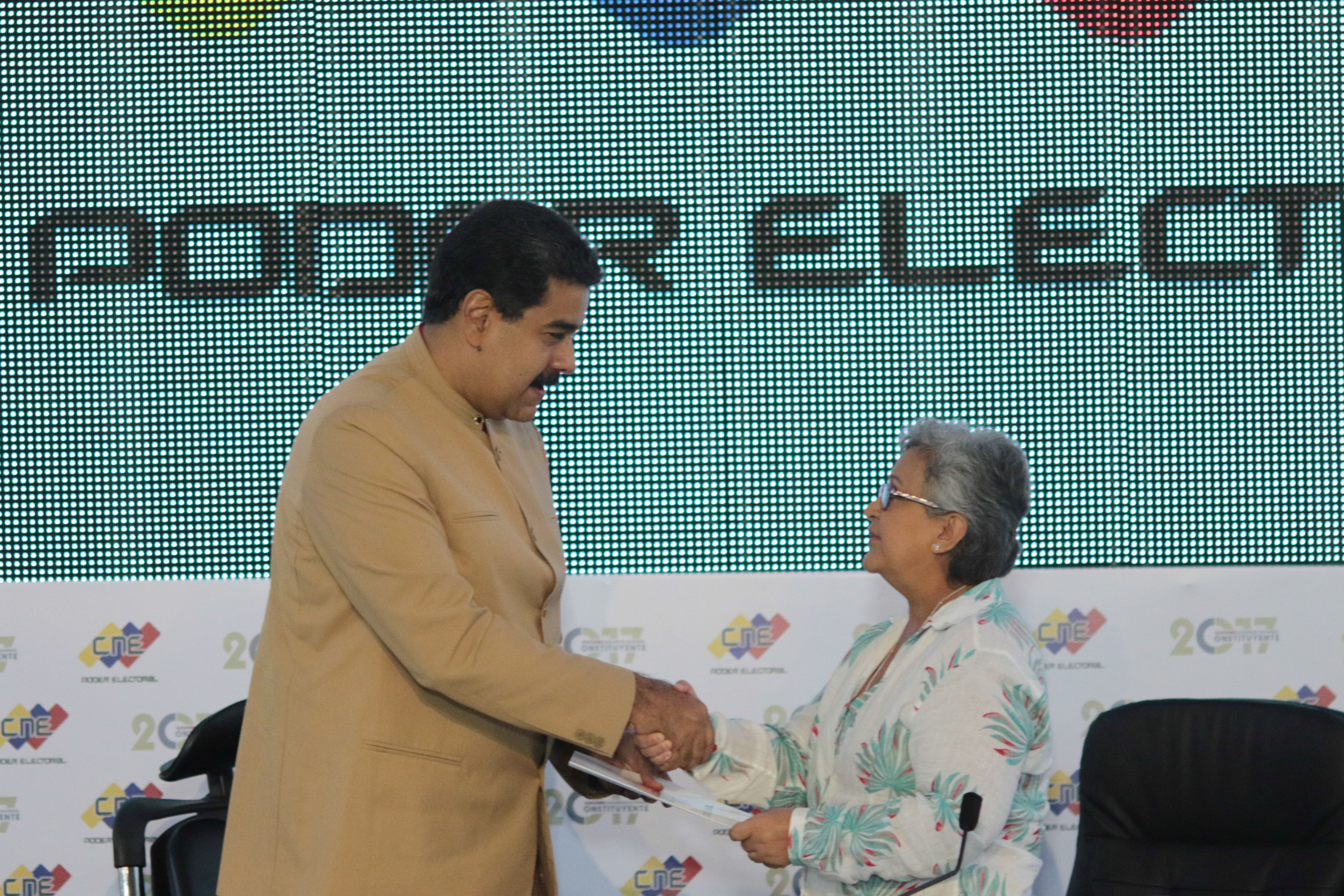 Venezuela's President Nicolas Maduro (L) and National Electoral Council (CNE) President Tibisay Lucena shake hands during their meeting in Caracas, Venezuela July 31, 2017. Miraflores Palace/Handout via REUTERS ATTENTION EDITORS - THIS PICTURE WAS PROVIDED BY A THIRD PARTY.