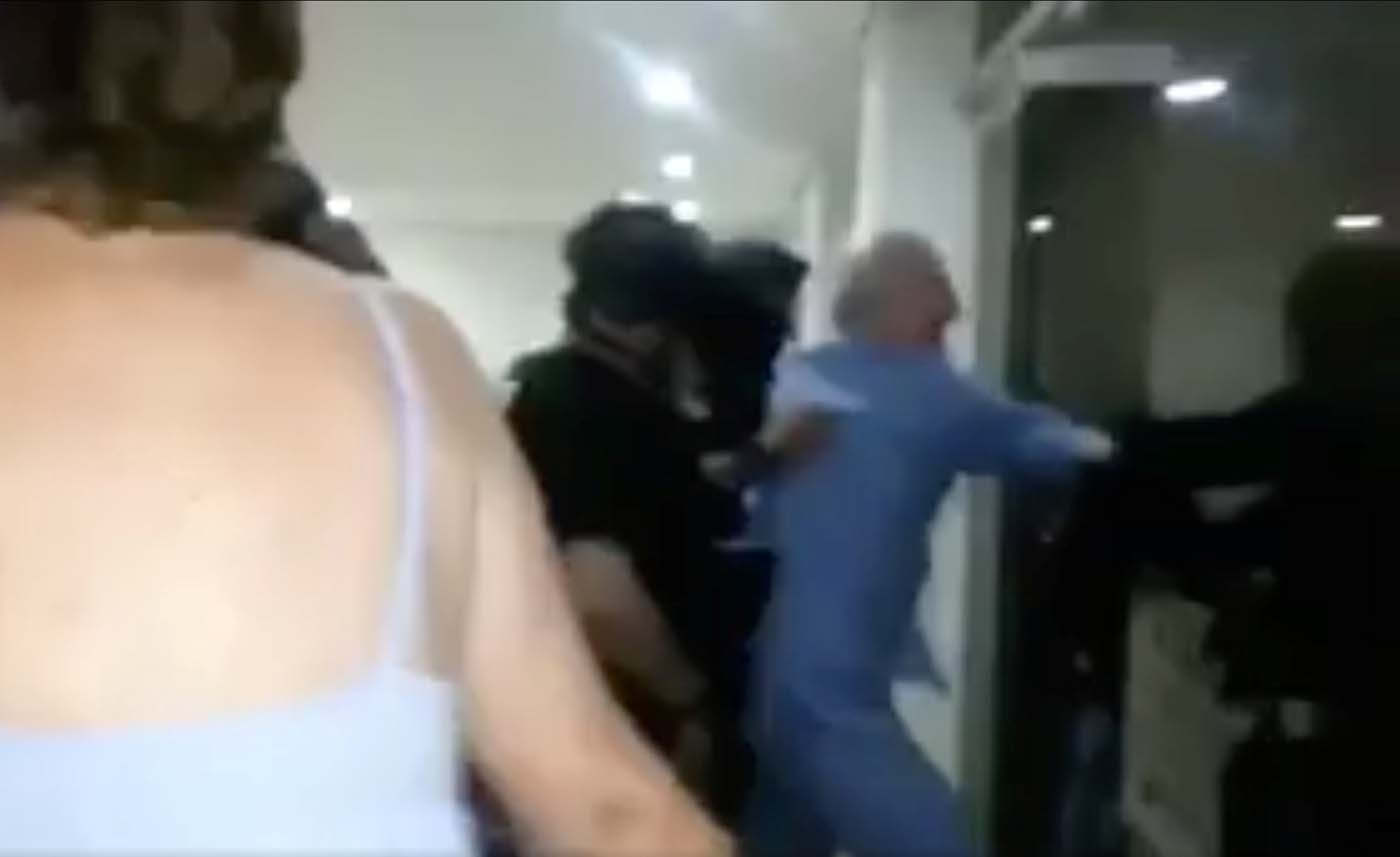 A still image taken from a social media video said to show the moment in which former Caracas Mayor Antonio Ledezma (in blue) is led under arrest from his home, in Caracas, Venezuela August 1, 2017. Social Media/Handout via REUTERS ATTENTION EDITORS - THIS IMAGE HAS BEEN SUPPLIED BY A THIRD PARTY. NO RESALES. NO ARCHIVES