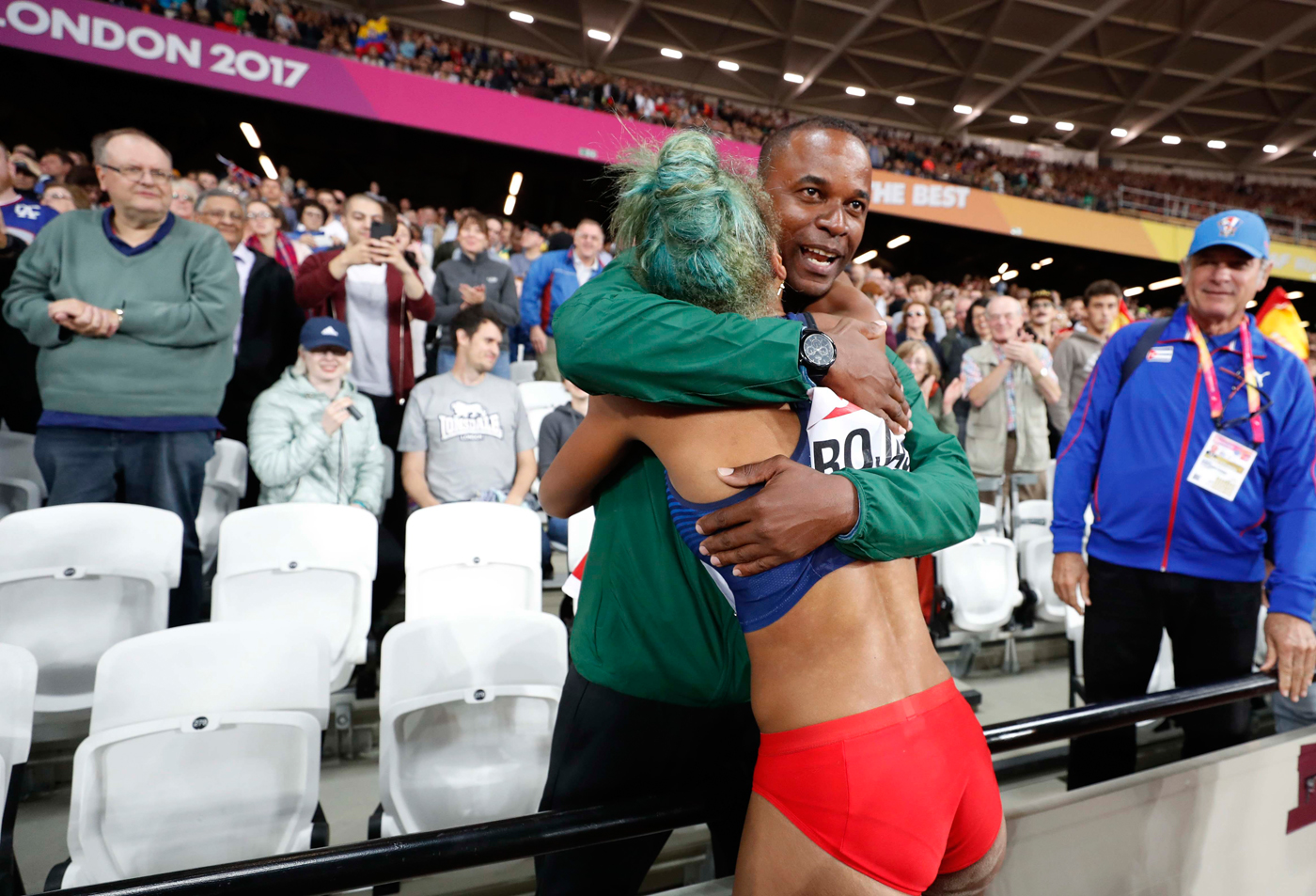 Athletics - World Athletics Championships - Women's Triple Jump Final – London Stadium, London, Britain - August 7, 2017. Yulimar Rojas of Venezuela celebrates winning gold with her coach. REUTERS/Phil Noble