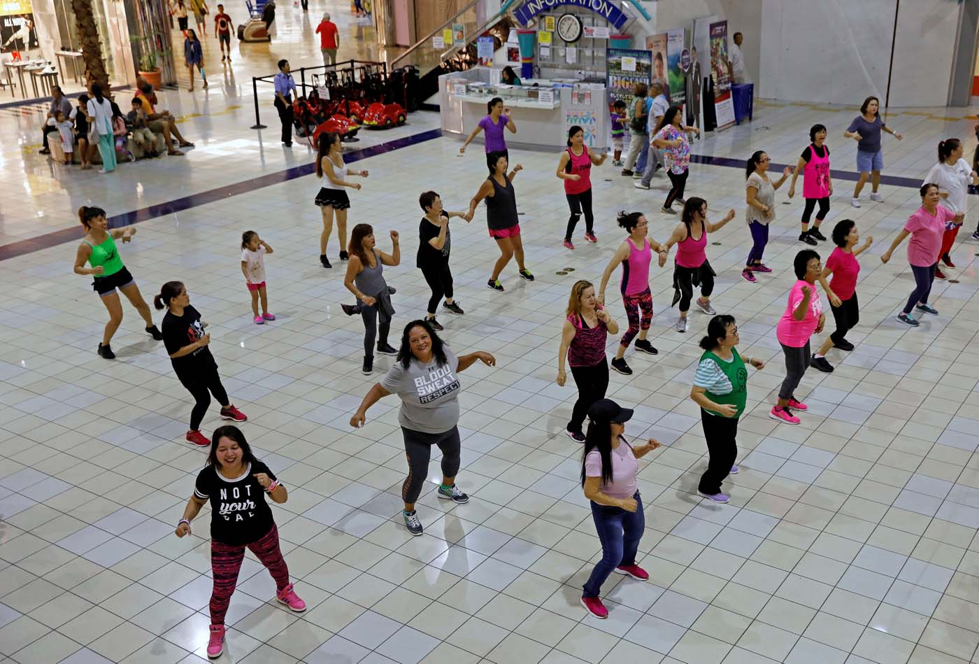 Residents do their daily routine Zumba class inside a mall on the island of Guam, a U.S. Pacific Territory August 10, 2017. REUTERS/Erik De Castro